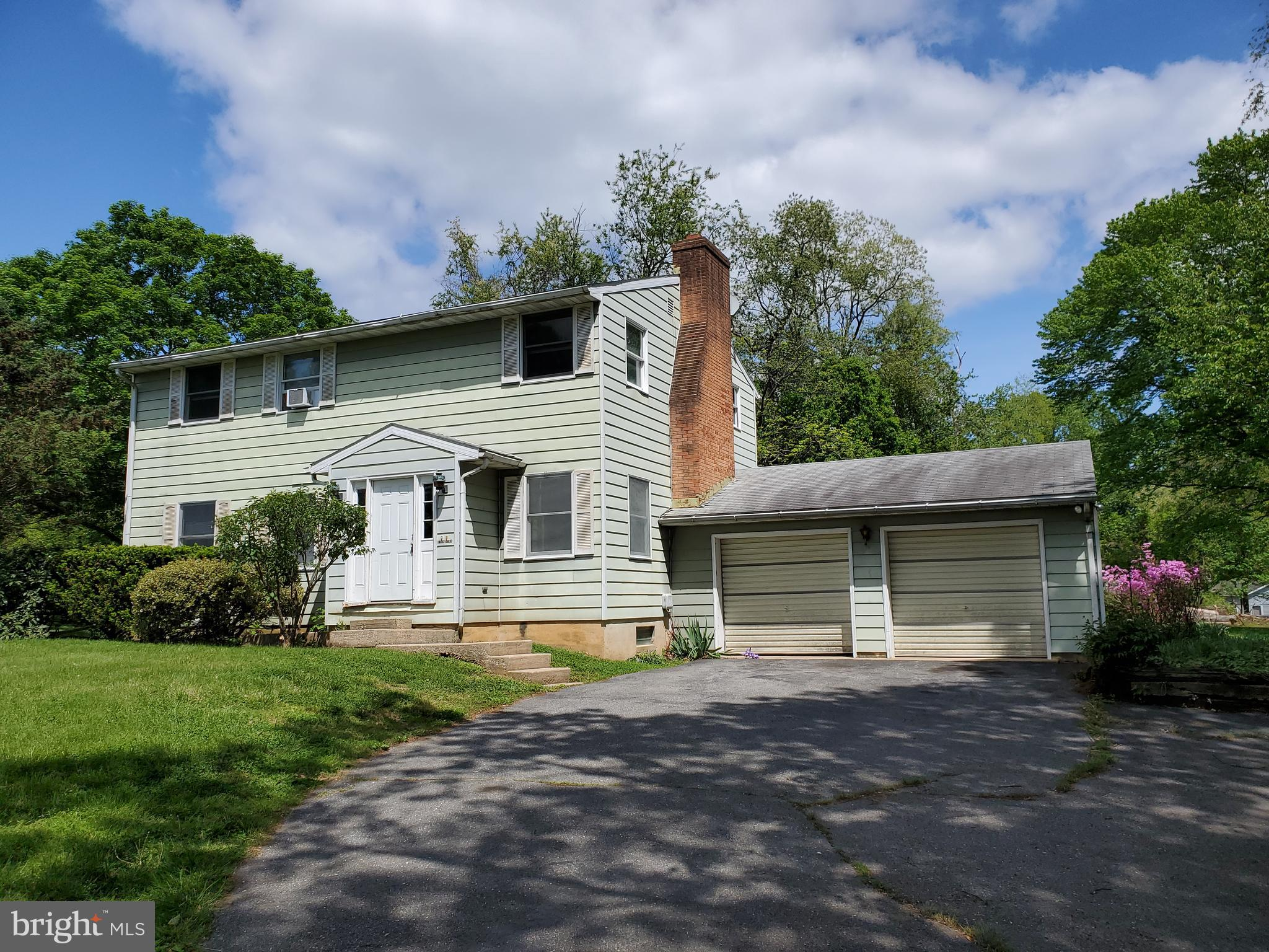 This great opportunity for a two family house or large single family home.  Living room with firepla