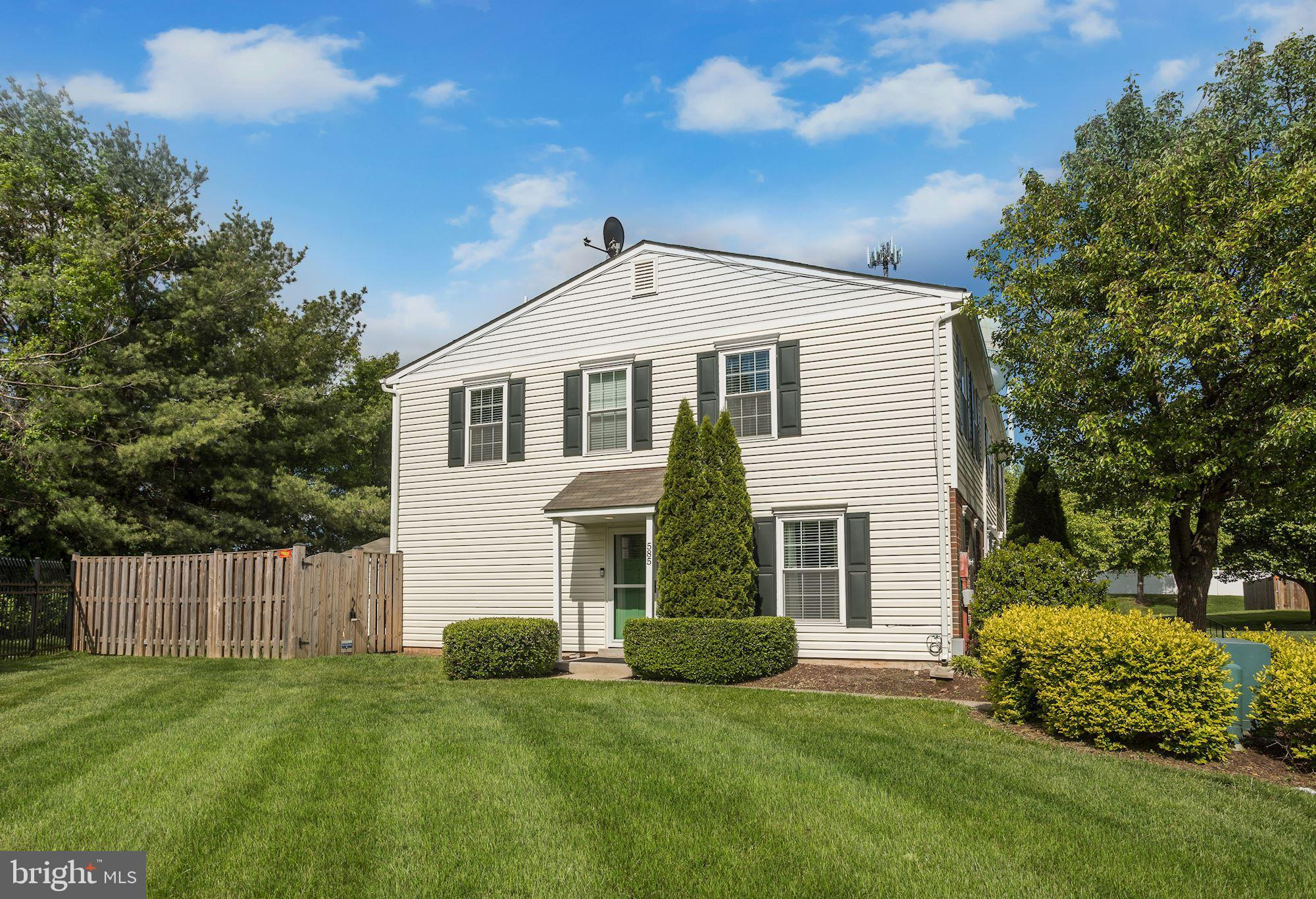 Completely renovated end of group townhome located in the Frederick Heights community boasting gleam