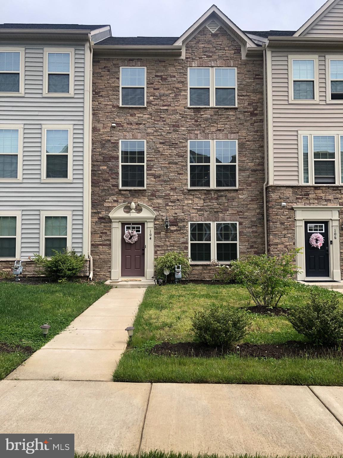 Welcome to 104 Sweetgum Court, an Immaculate 3 level town home in Embrey Mill.  The front yard overl