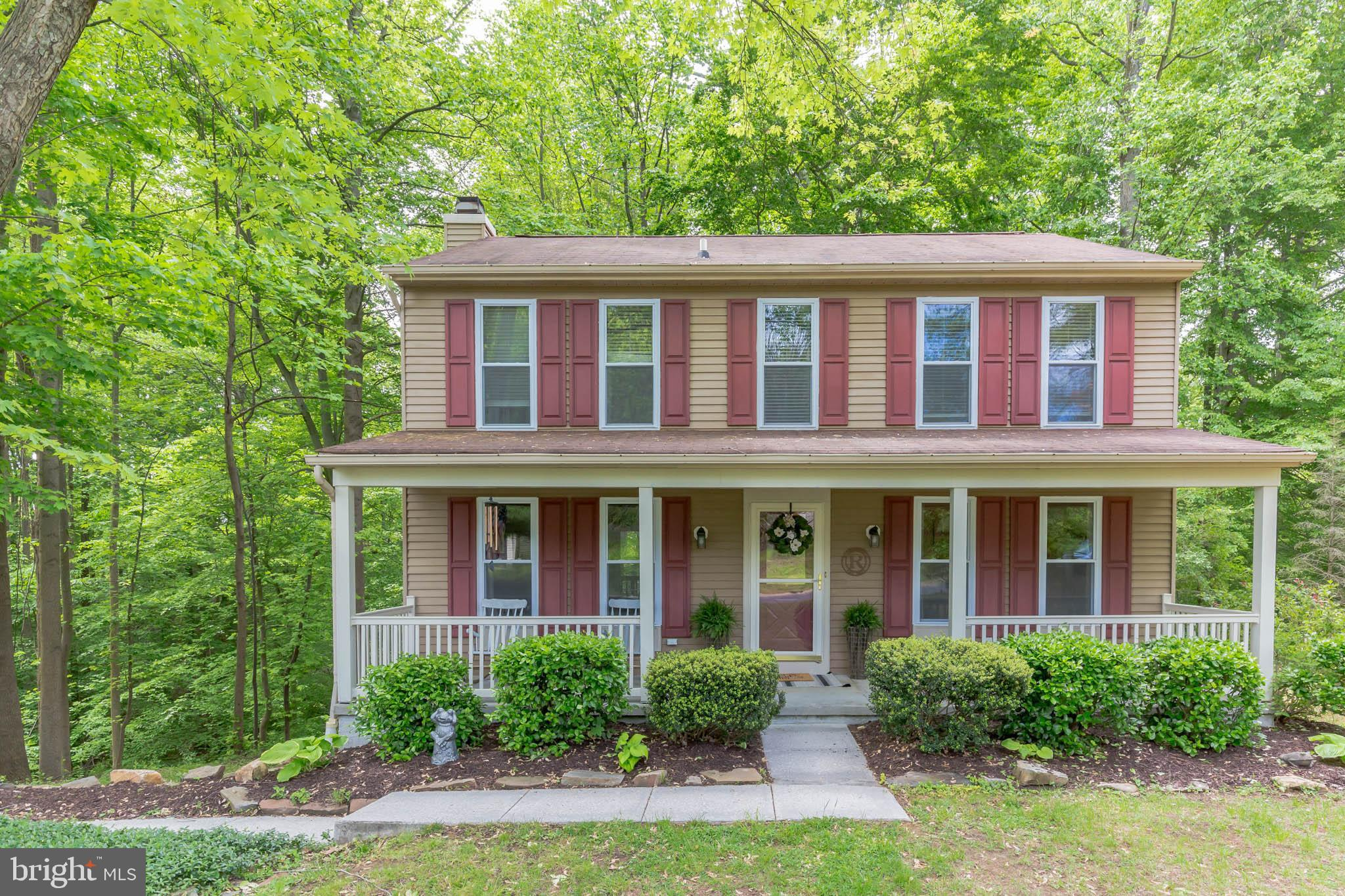 A perfect blend of privacy and convenience.  This charming porch-front colonial is situated on a uni