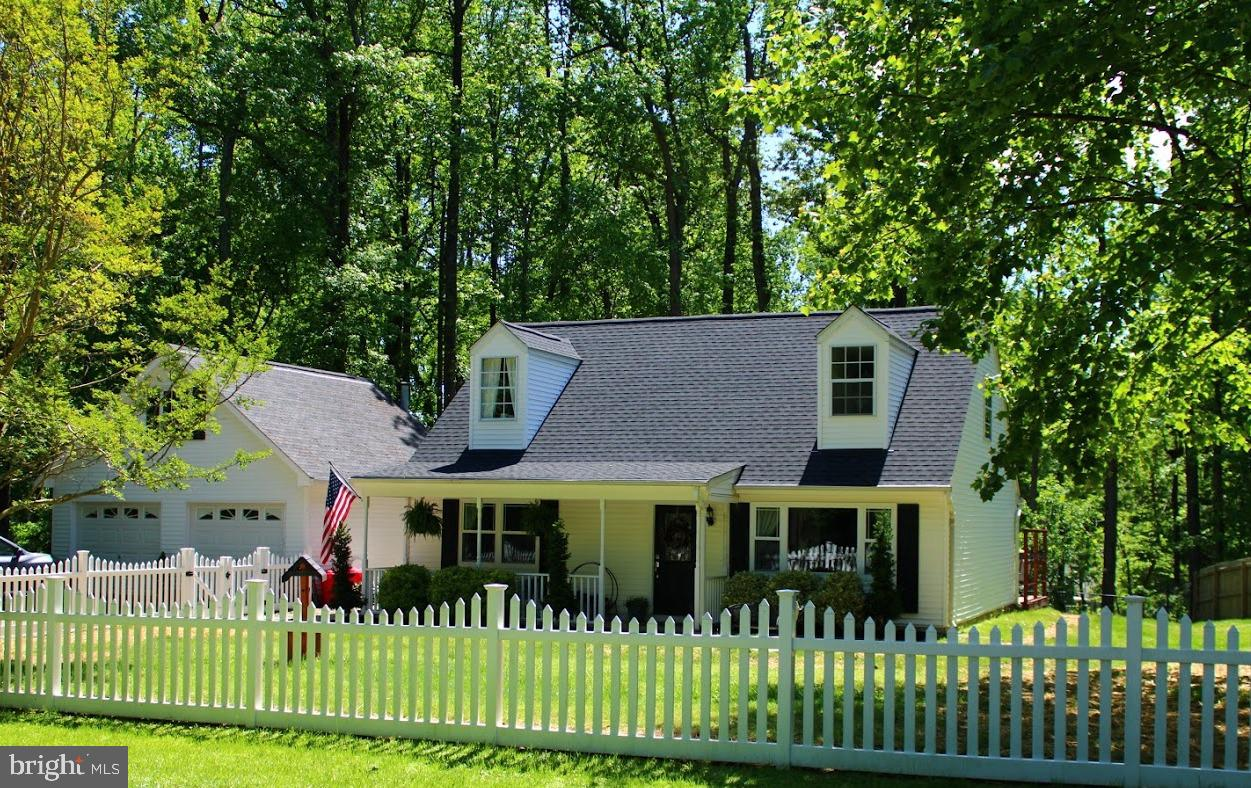 Public open house Sunday May 16th 1-3.    LOVELY CAPE COD ON JUST UNDER AN ACRE * 3 BEDROOMS * 2 FUL