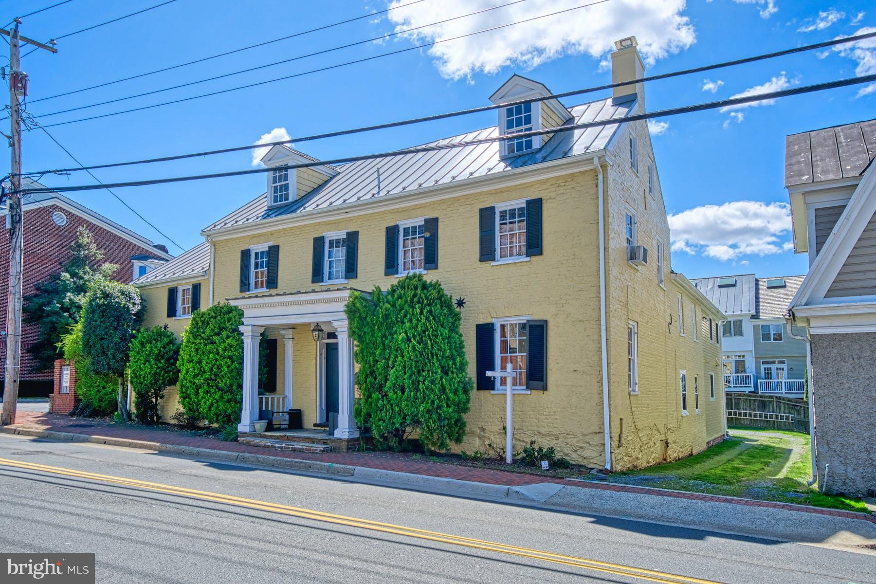 Circa 1810...Brick Federal home in the heart of the downtown Leesburg Historic District.   Be in the