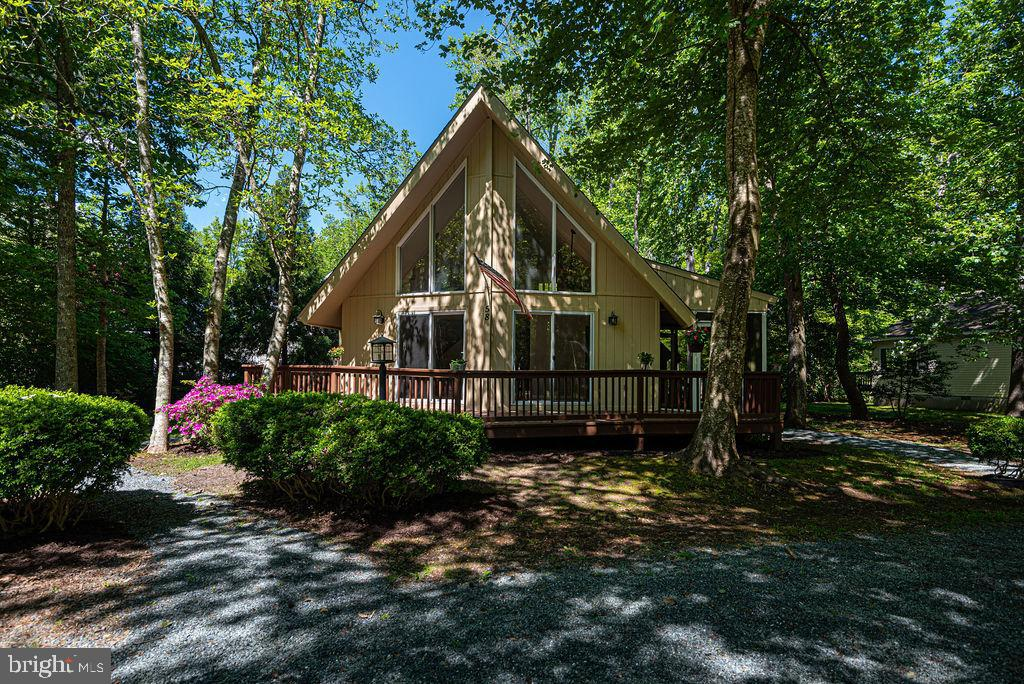 """SHINES LIKE A NEW PENNY...  Don't let this """"like new"""", 3 bedroom, A-Frame home pass you by.  Tucked"""