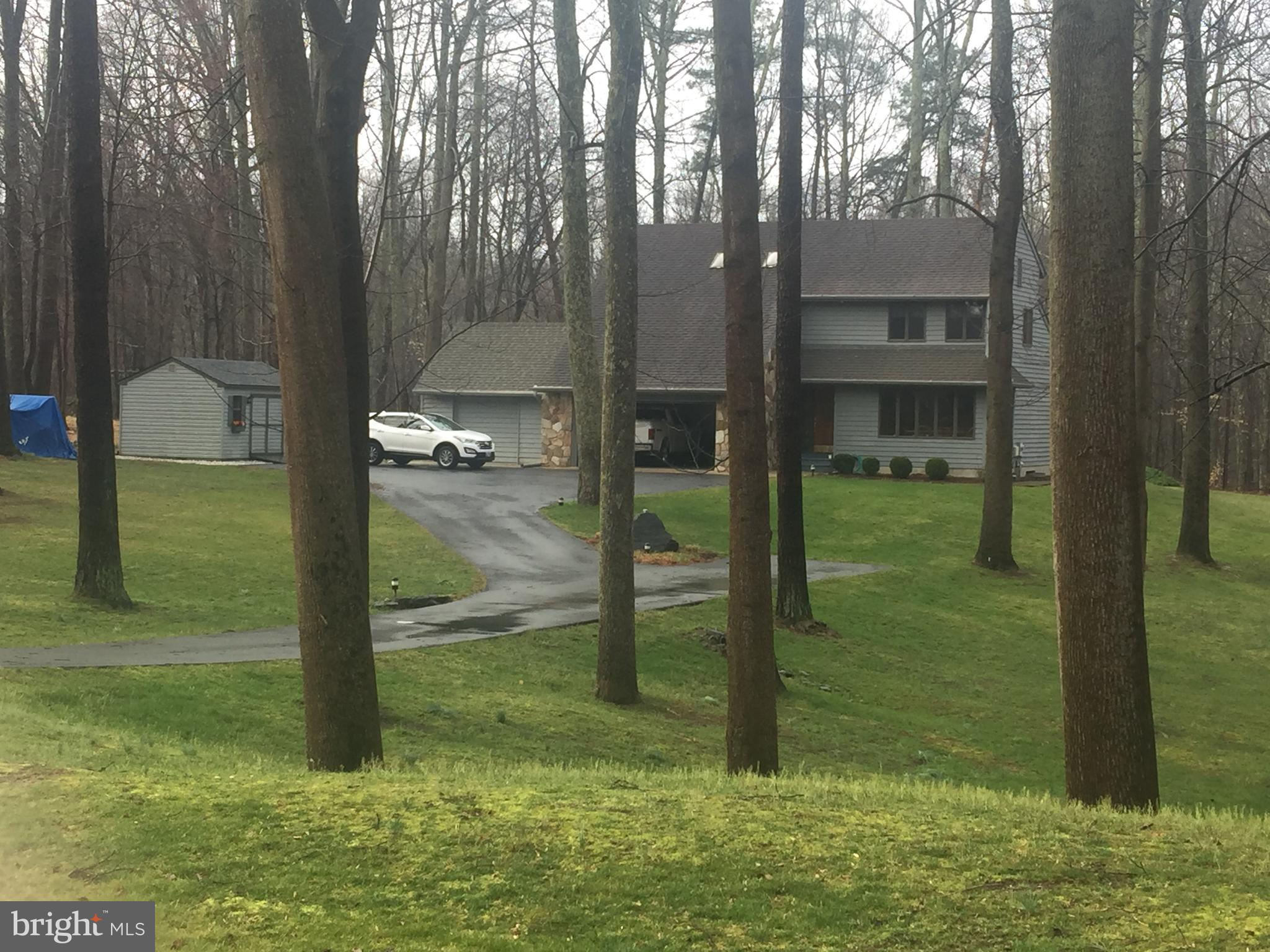 Beautiful, Well Maintained Home on 1.20 acres private setting surrounded by trees.  Home sits back o