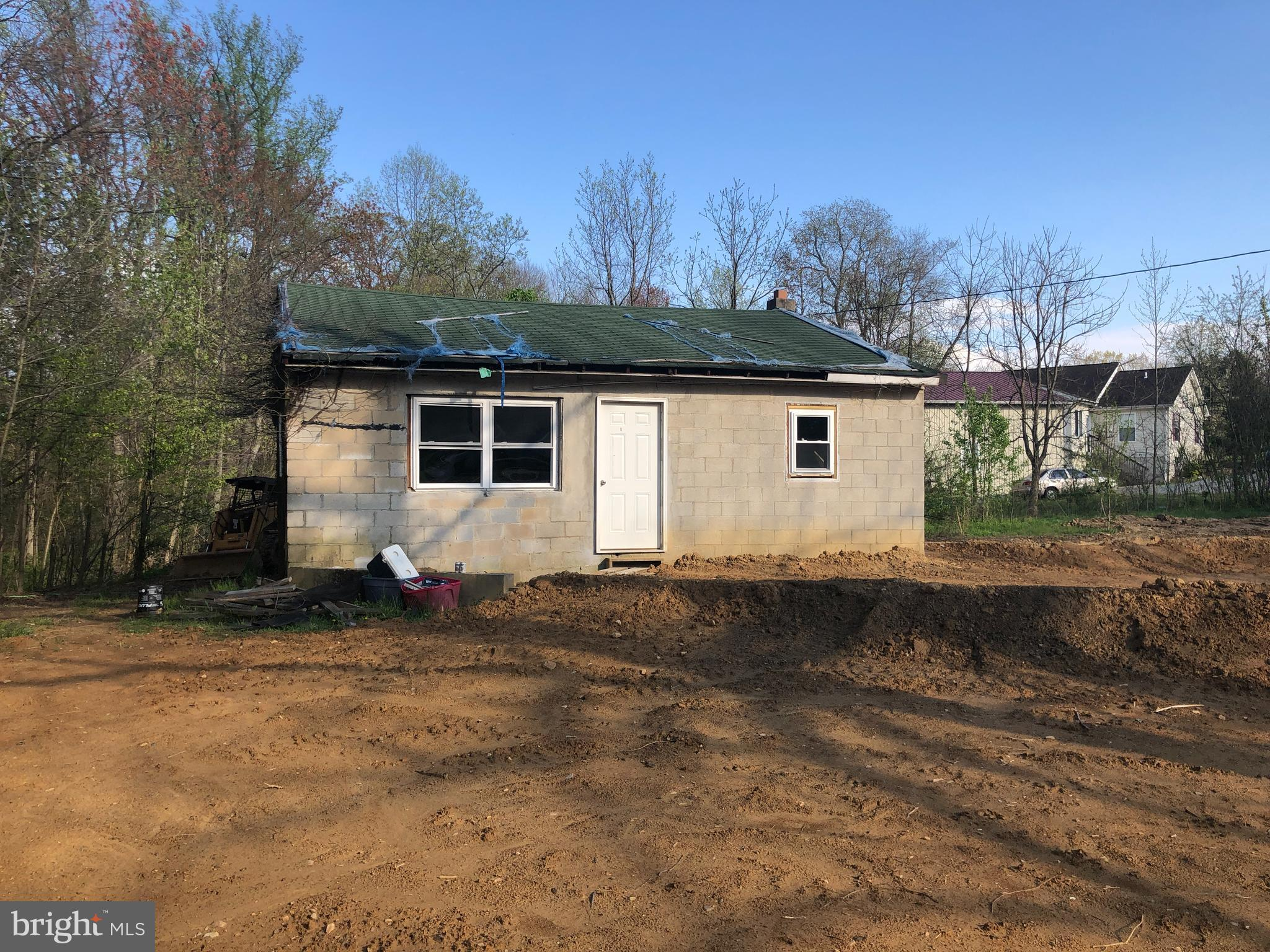 Nice comfy Bungalow! Own 1 full acre and your own private stream!  Renovations were started but neve