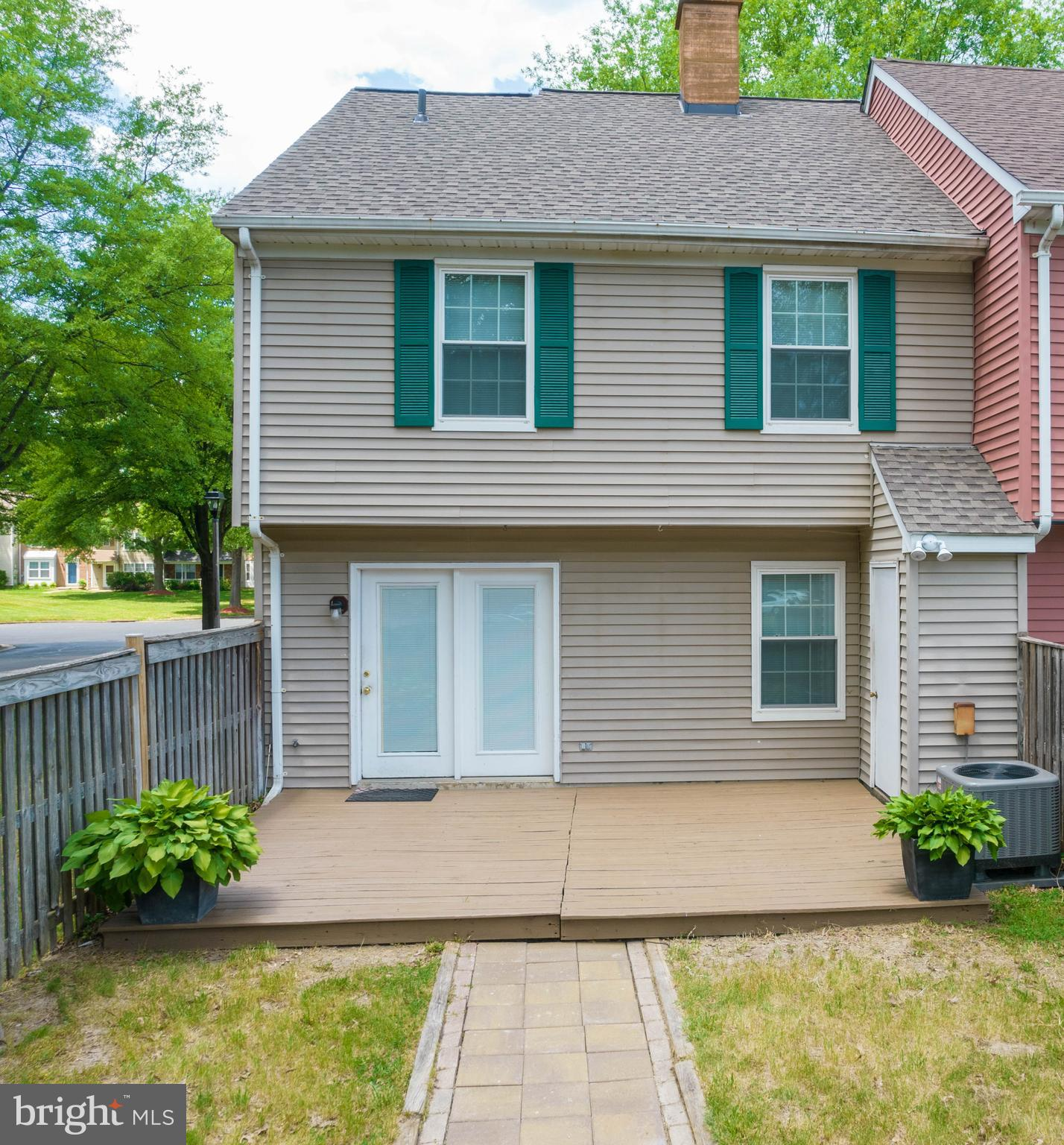 A Must See!! This well maintained 2 level End Unit Town Home  features Hard Wood Floors, Roof and HVAC less than a year old , Upgraded Windows, Ceiling Fans in all the rooms, Freshly Painted.  Close to Shopping and Restaurants. This property has 2 HOA'S. 1 Annually for 329 the 2nd for 70.17 monthly.
