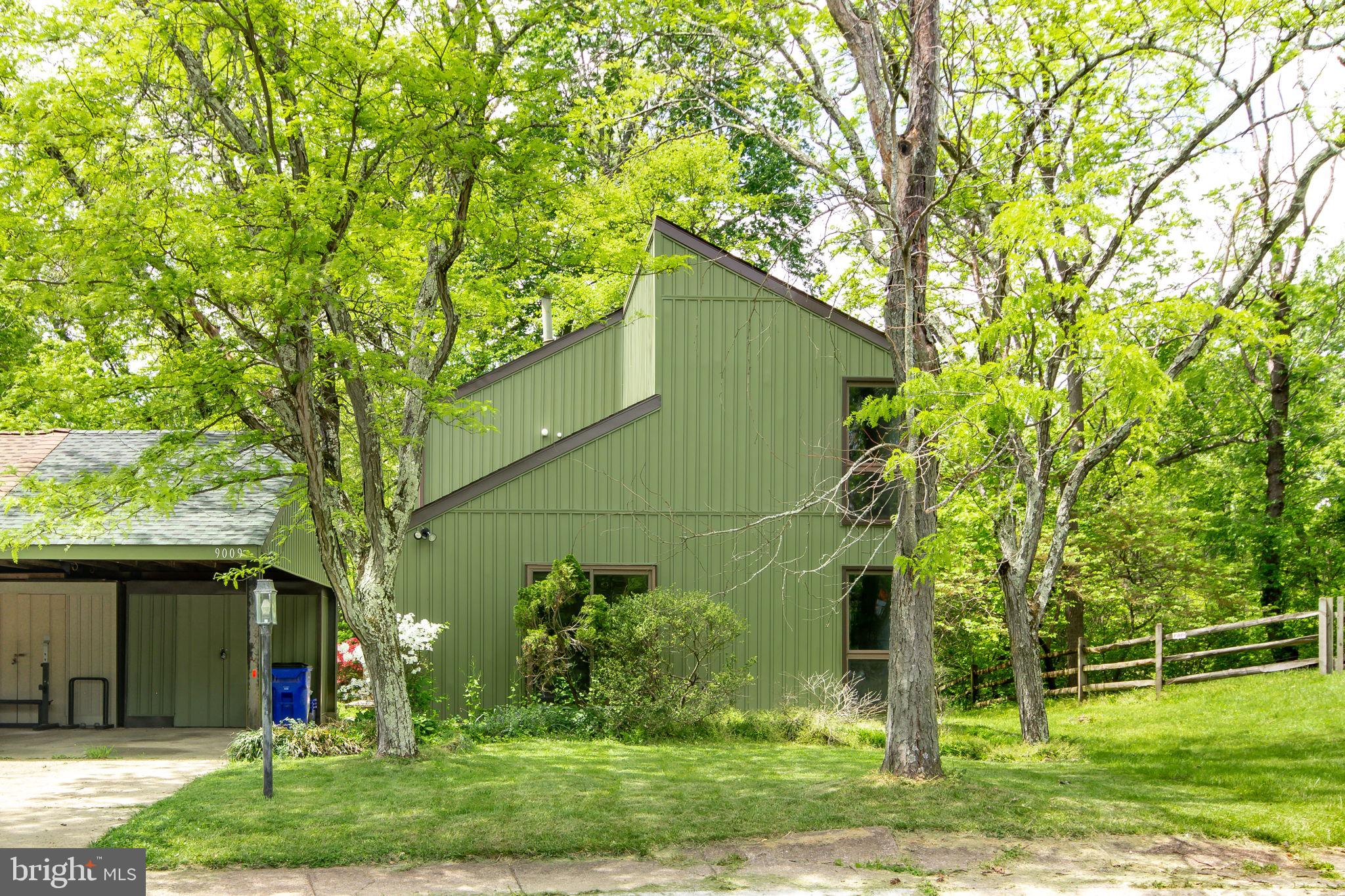 Welcome to this rarely available contemporary nestled on a quiet cul de sac backing to trees offerin