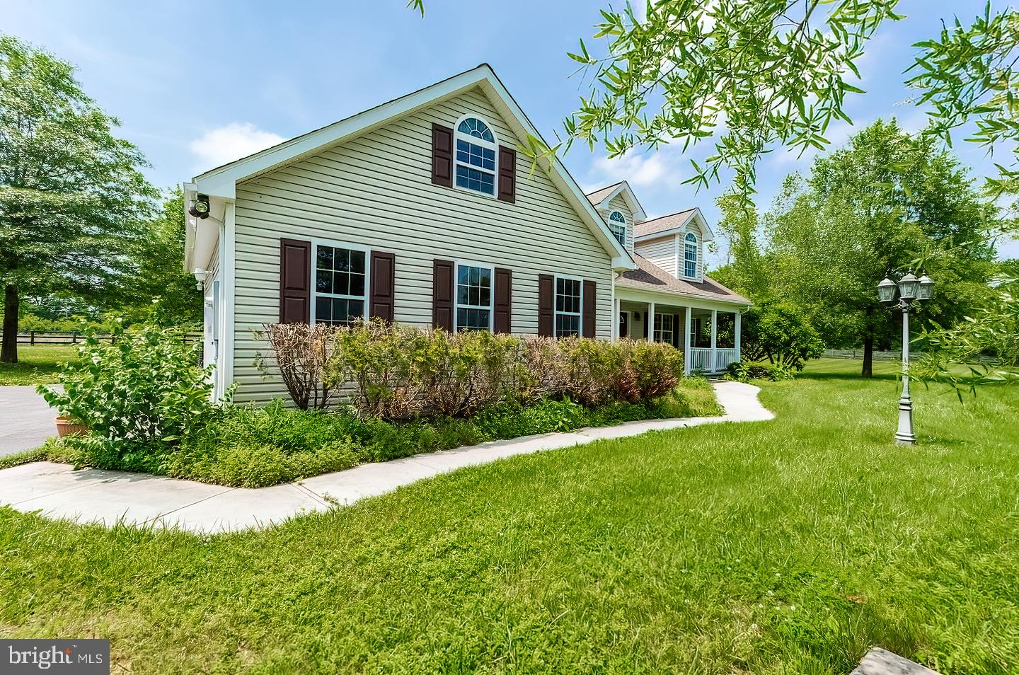 Luxurious 4 bedroom,  Cape Cod loaded with many upgrades  to include hardwood & ceramic floors, gran