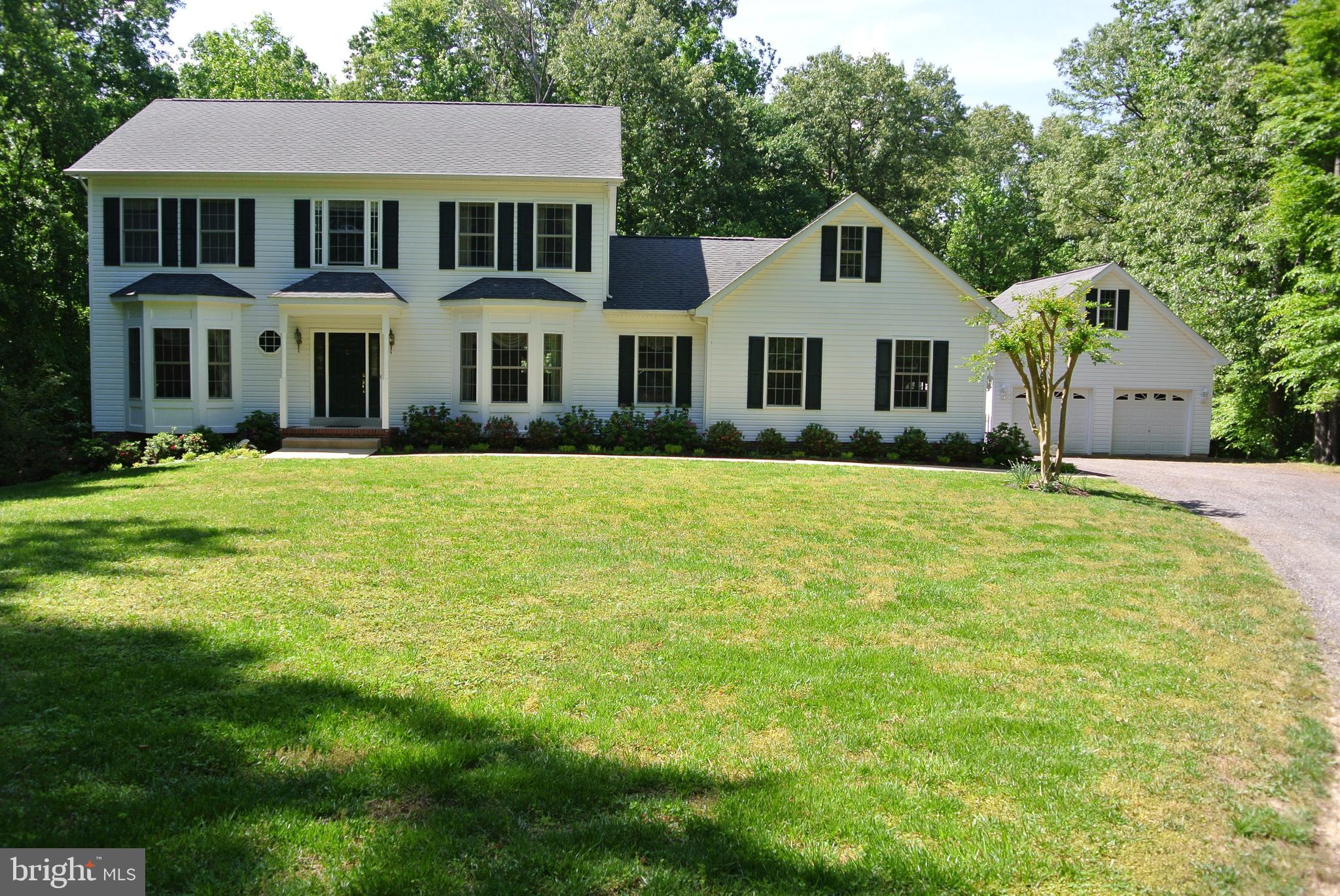 Pack your bags, this is your new home! Beautiful Colonial on almost 12 Acres. This home has it ALL.