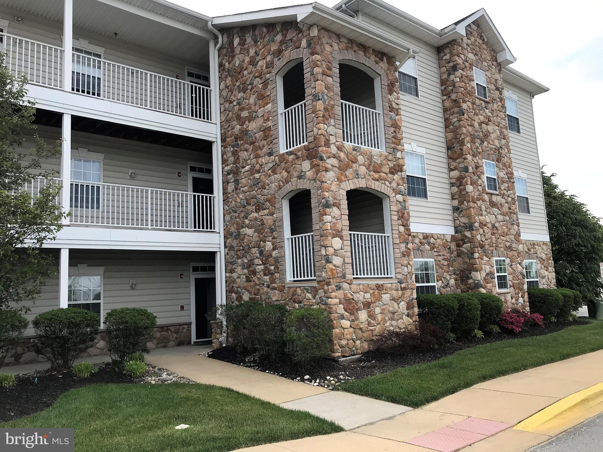 Rarely available, upscale condo in the active adult community of Steeple Glenn! This former model un