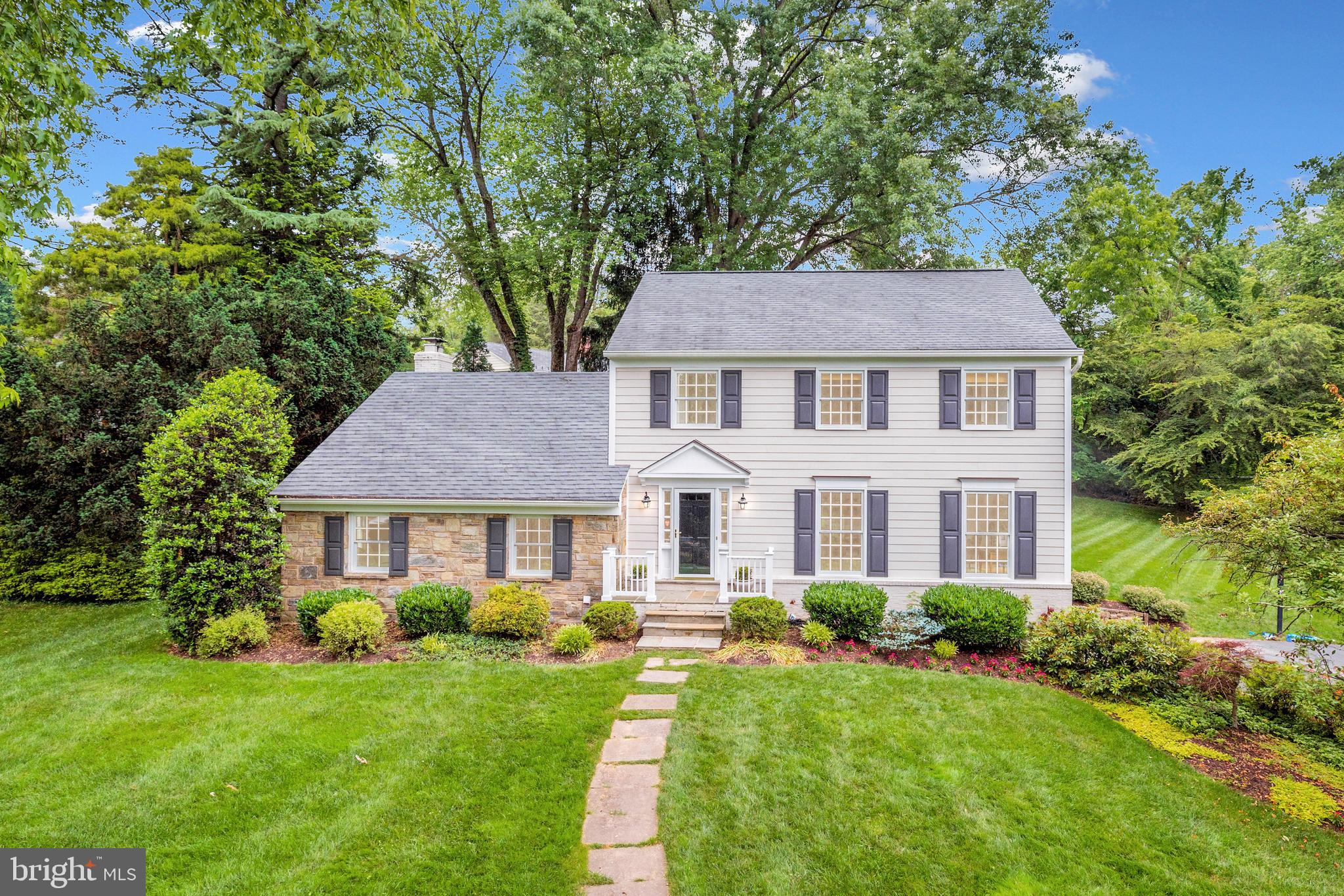 Charming stone  front & hardiplank colonial on over one half gorgeous acre in sought after community