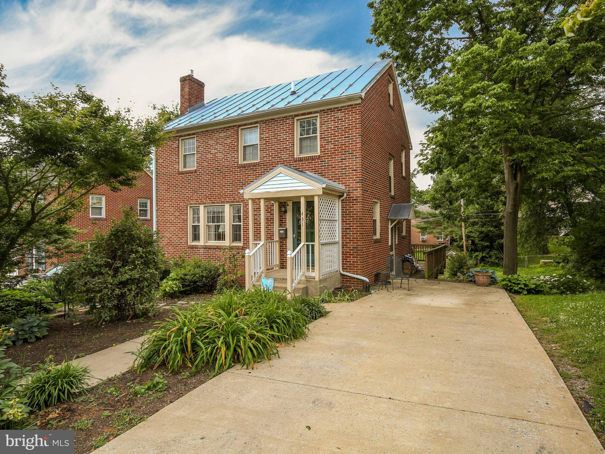 This lovely colonial is located in the heart of Winchester and is situated across  from the Handley High School campus.  Built in 1956, it has retained much of its original charm with all hardwood floors,  arched doorways, and built-ins.  The full bath on the upper level has been updated with a large walk-in shower.  The sunroom located in the rear of the home boasts  vaulted ceiling and windows galore which overlook beautiful gardens, with flowering shrubs, trees, and numerous  blooming flowers, which the seller has lovingly planted and cared for through the years.  Extensive hardscapes such as brick walkways, patios, and stone wall in the rear gardens.   A new gas fired hot water boiler was installed in 2017.  New vinyl windows have been installed throughout the home.  The washer/dryer have been located to the main level of the home, but can easily be moved back to the lower level to return the dining area to its original size.   Conveniently located for shopping and dining in downtown Winchester.
