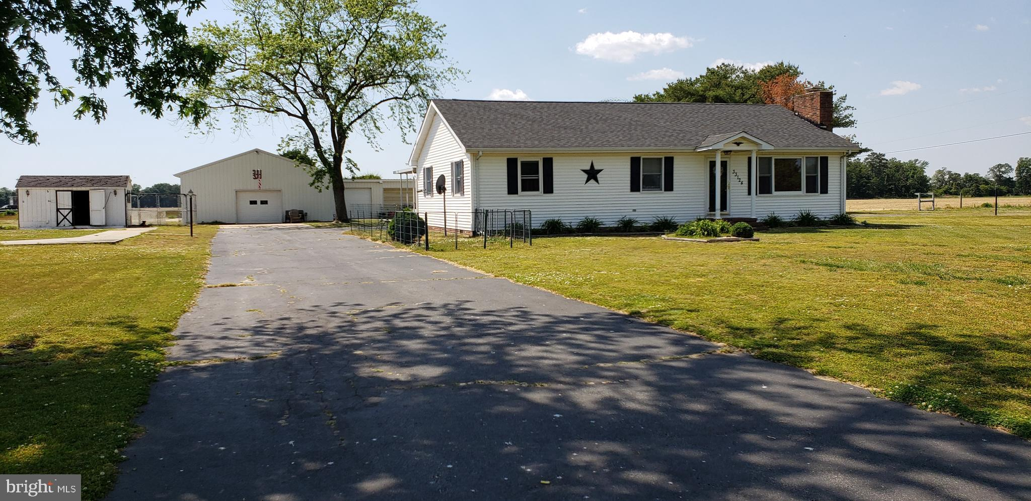 Lots of possibilities with this property! 5.06-acre parcel with a 4 bedroom 2.5 bathroom home.  Hors