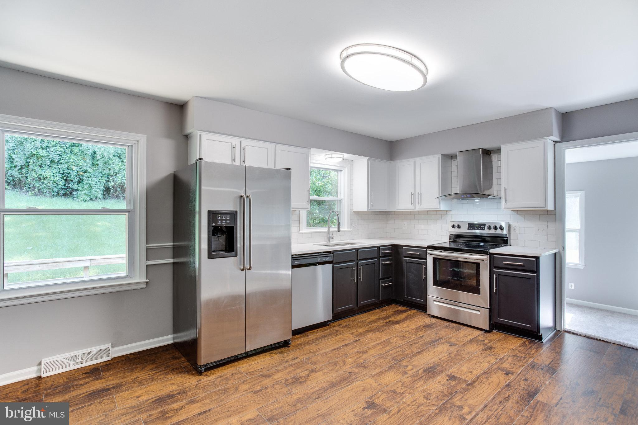 Priced To Sell Fast! Desirable Remodeled Rambler, Updated Kitchen with Quartz Counters, Stainless St