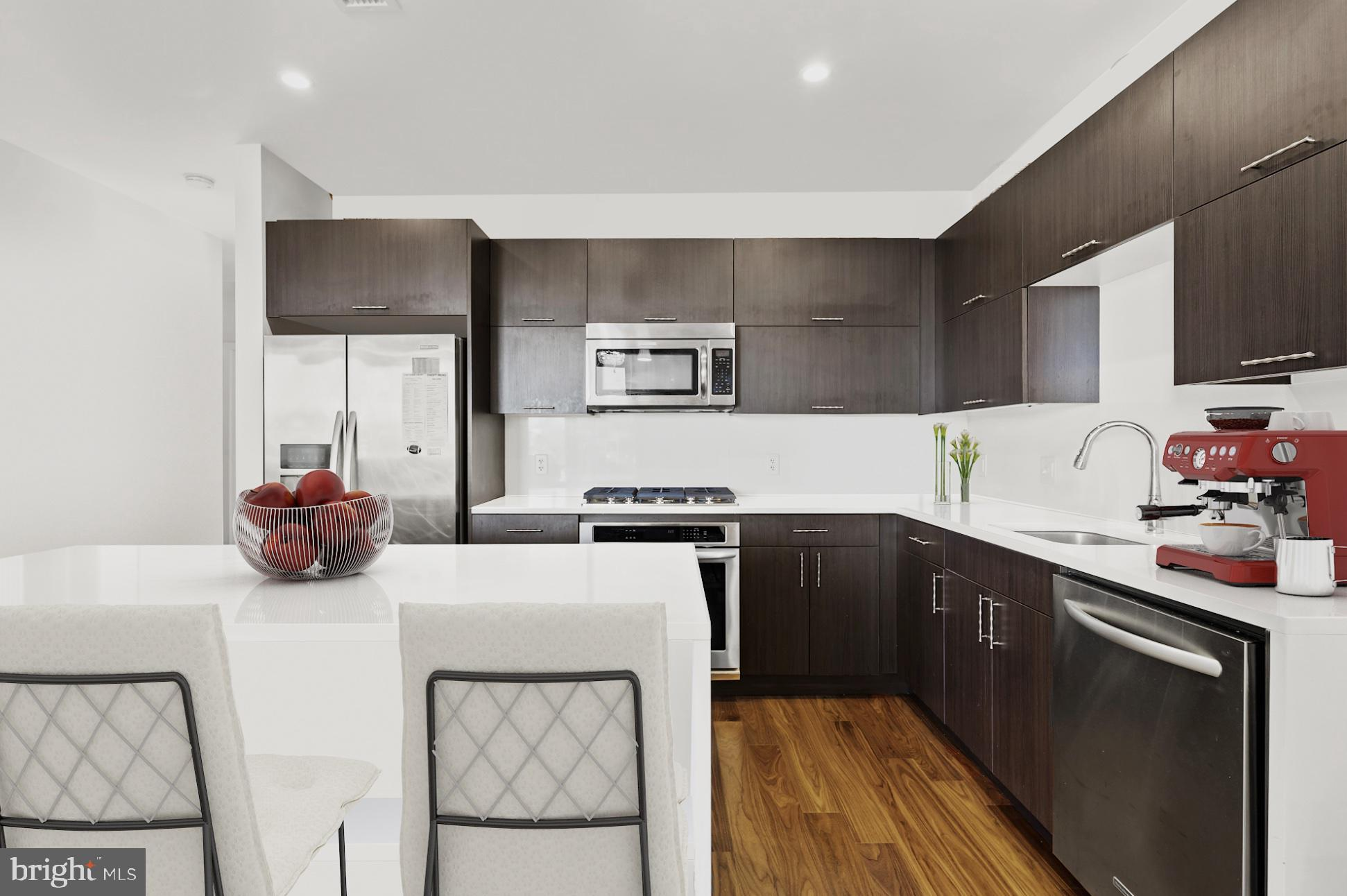 Move-in ready penthouse in a newer building! Top floor 2 bedrooms, 2 full bathrooms condo with a  ba