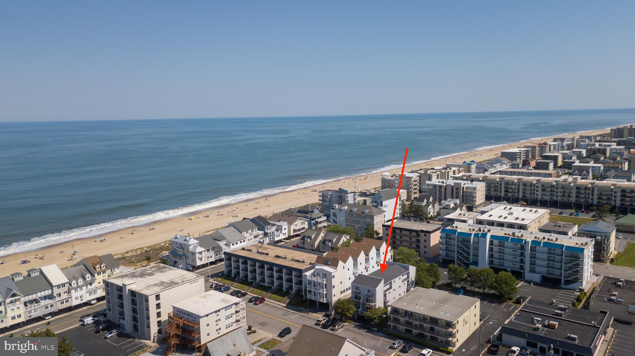 Enjoy a peek at the ocean from the generous balcony of this spacious ocean block condo located in North Ocean City just 2-blocks from the MD/DE line. The unit features open concept living with a kitchen peninsula for storage, dining area, living room, full vanity in the bath and a roomy bedroom. Ample opportunity for you to design your very own beach retreat. Well maintained building and great association. Parking includes 1 assigned space under the building and 1 additional assigned space that is shared on a first come first serve basis with another unit. Located close to restaurants, mini-golf, shopping, movie theater and Famous Fisher's Popcorn.