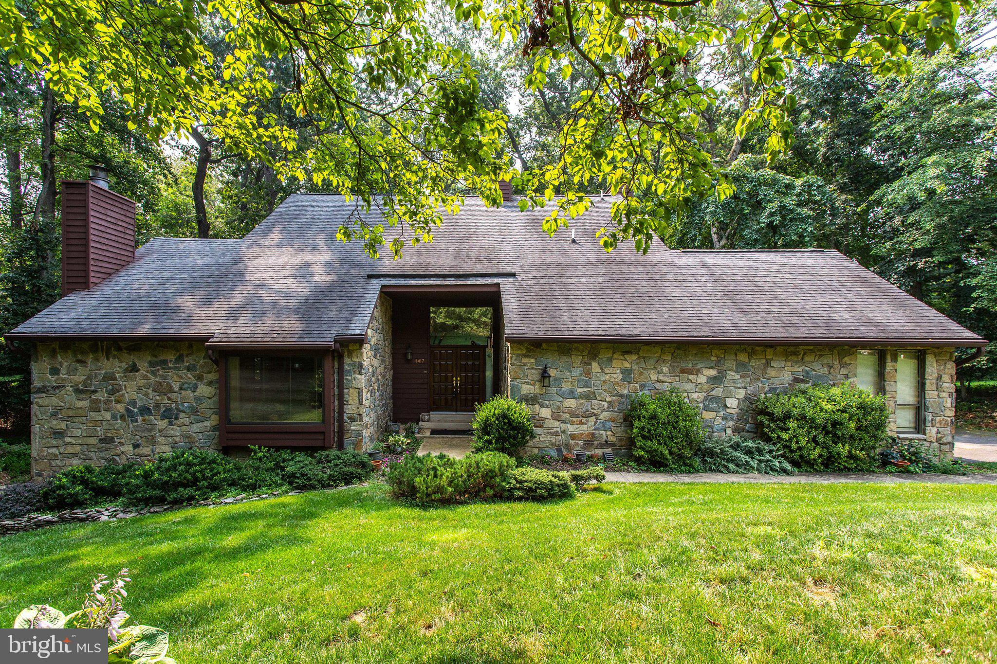 Walk to Wolf Trap from this expansive 3 level contemporary home, nestled on a serene wooded  lot.  T