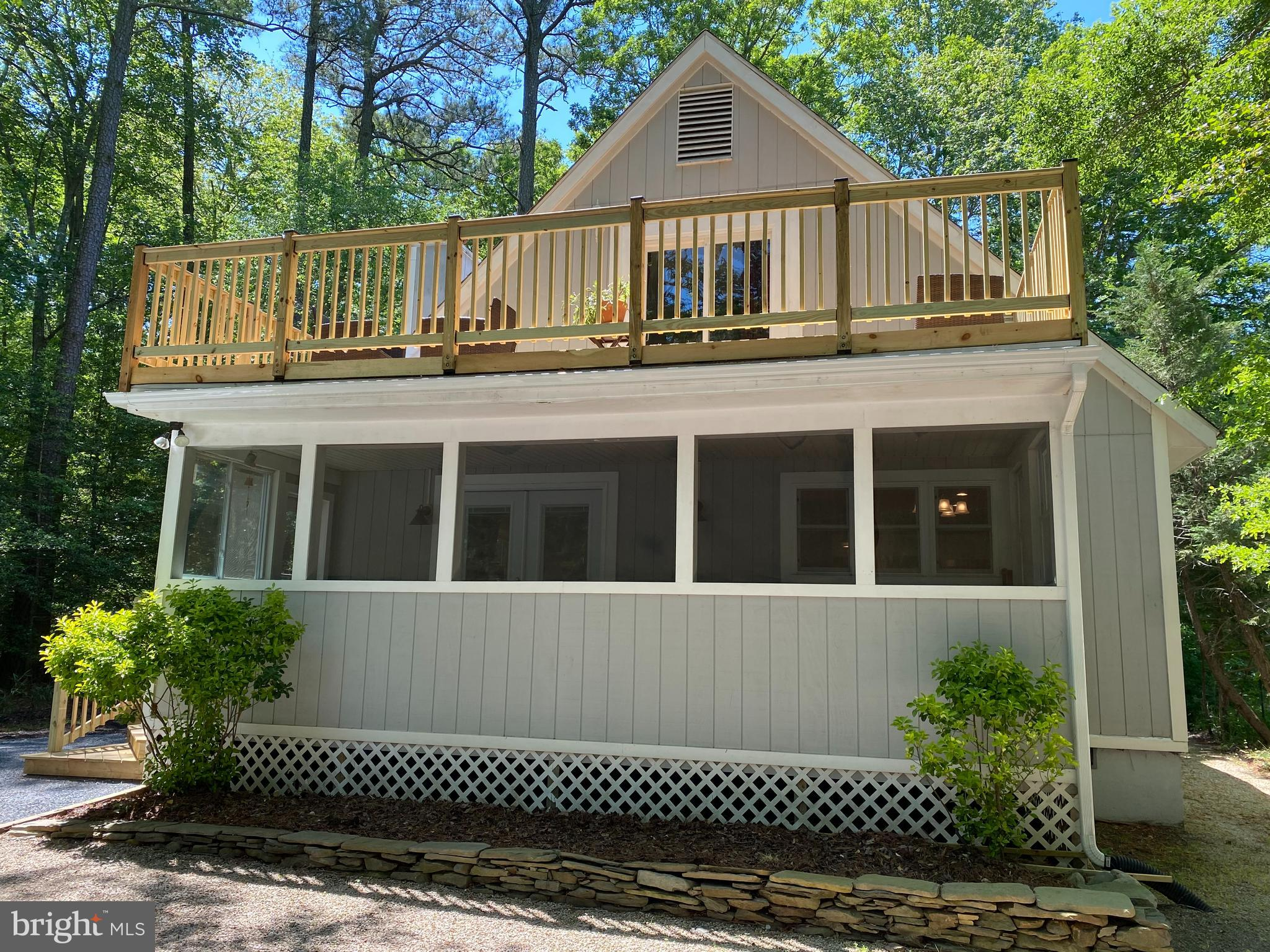 Beautiful new listing in desirable Ocean Pines.  This home features a nice open floor plan and a large First Floor Master Bed & Bath.  New in 2018 includes upgraded lighting fixtures throughout,  which are LED, pendant lights, beautiful shiplap in the Living Room, custom built mantel over the wood burning fireplace,  carpet in bedrooms, replaced planks on 2nd story decking as well as railing, new front entry deck, refinished the main stairwell,  re-insulated hip roof sections of the home, installed air ventilation for crawl space and hip roof sections of the home, Stainless Steel appliances including Fridge, Stove and Microwave, Dishwasher in 2020 as well as the Washer & Dryer.  New doors and windows on the 1st floor street side of the home were installed in 2020.  Bathroom light fixtures were upgraded in 2021.  Crown molding throughout the 1st floor, adds a nice touch.  Roof is approximately 8 yrs old as well as the water heater and upper level HVAC.   Priced to sell, this home will not last long!  Professional photos coming.