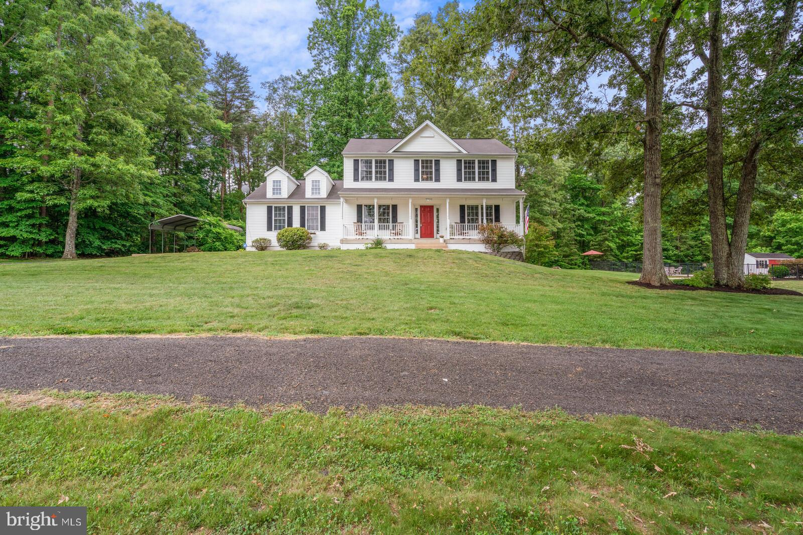 Exceptional colonial with beautiful in-ground pool on 6.5 acres in Spotsylvania, VA.  The kitchen with stainless steel appliances, island and large pantry opens to the breakfast area and family room with gas fireplace. Beyond the sliding glass doors, a 24 X 12 deck makes outdoor gatherings easy.  The main level also includes a separate dining room, sitting room, half bath and laundry.  Hardwood floors flow from the kitchen through the breakfast area, hallway, foyer and up the stairs.  The second level features the owner's suite with double vanity and walk-in closet, two additional bedrooms and a full bath.  Head to the lower level to enjoy a spacious recreation room with pool table, large bar area, hobby/weight room, full bath and a laundry/utility room.  The walk-out offers easy access to the pool and pool house with its full-size refrigerator.  A large detached garage with four high bay doors provides additional indoor parking for up to 6 vehicles.  A carport allows even more covered storage for watercraft, vehicles or equipment.  Mature woods to the side and rear of the property deliver privacy and views of nature.  A gutter guard system reduces maintenance and the zero-turn mower included with the sale will help you spend more time at your pool!