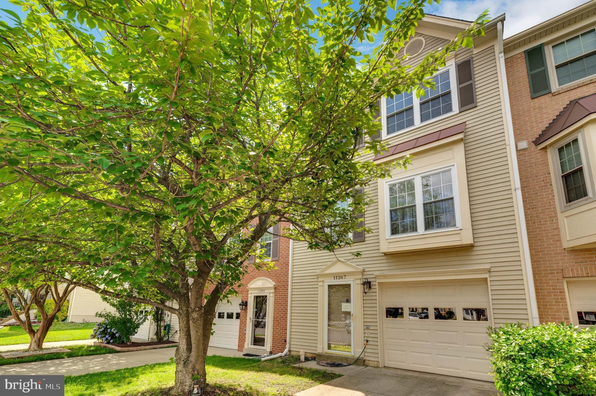 Welcome home to this beautiful 3 level Colonial style townhome in in sought after Paradise neighborh