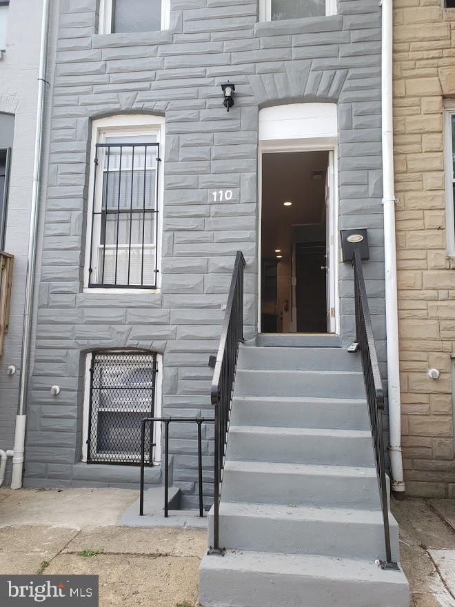 """Offering buyer's closing assistance. Totally renovated townhouse with full, finished basement! Private courtyard with a GARAGE/WORKSHOP!  Stainless Steel Appliances, 40"""" Cabinets, Granite Countertops, 2 ceramic-tiled bathrooms, Central AC, Harwood Floors, Skylight, Close to the B&O Museum, Clare Station, The Hollins Market and Downtown Baltimore."""