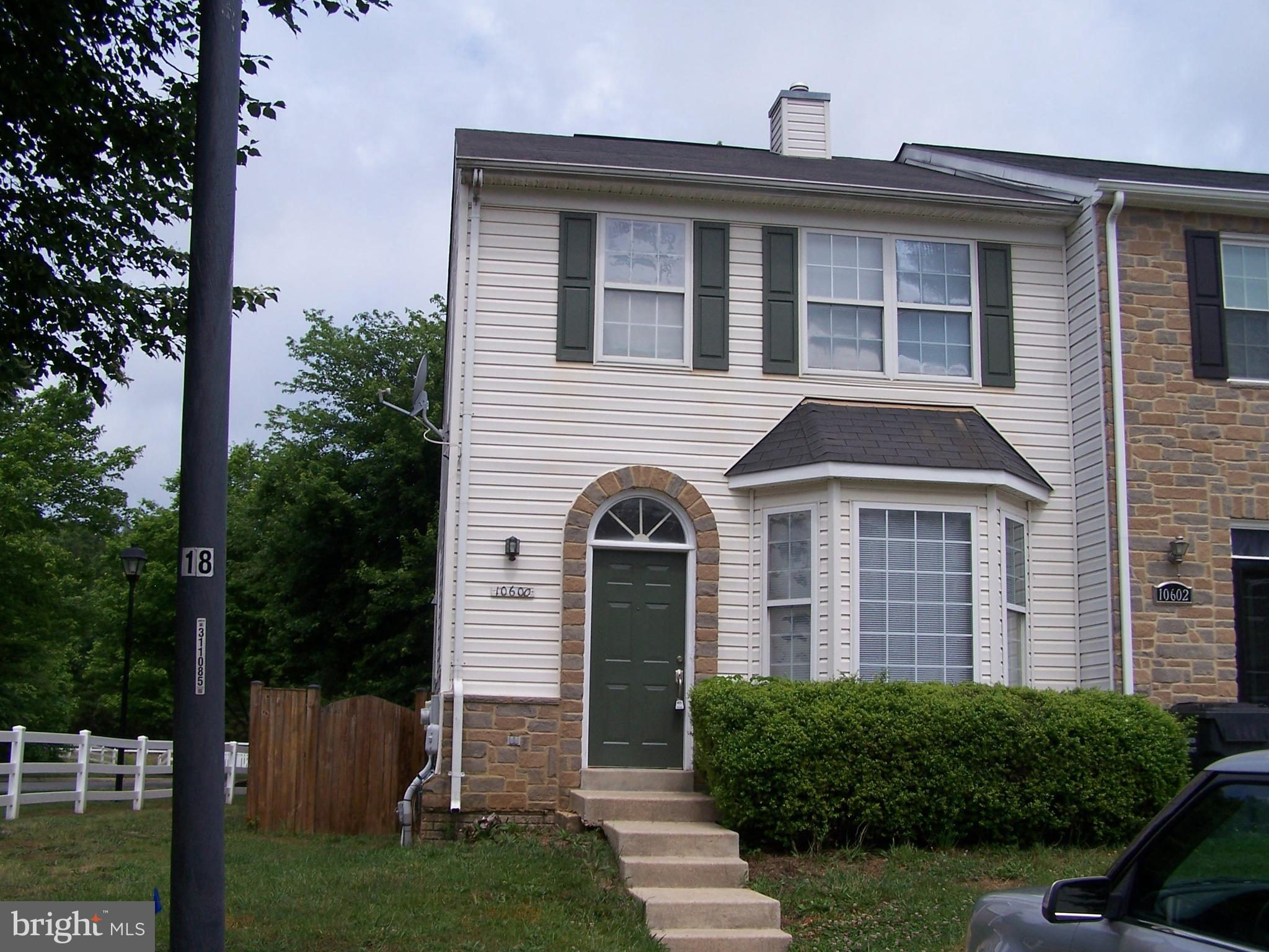 Spacious three level end unit townhome in Southwinds neighborhood with over 2,100 sq. ft. of finishe