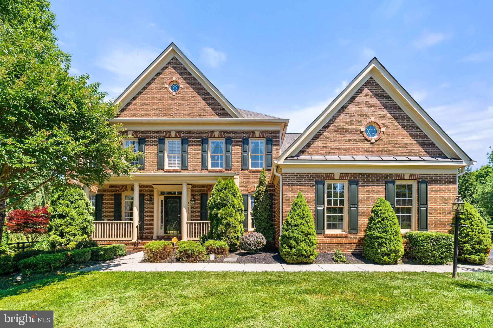 """Welcome Home to 17176 Westfield Pl., Hamilton VA 20158. Comcast Xfinity Highspeed Internet Available and Access to the WO&D Trail is Within Walking Distance of this Luxury Home Built in 2005. This Gorgeous All Brick Front Home Includes 6 Spacious Bedrooms, 4 Full Baths, 1 Half Bath, with 6,190 Estimate Square Feet of Finished Living Space. The Home is Perfectly Situated on 1.08 Fenced Acres, Simply Immaculate Inside & Out, with Gorgeous Design, Details and Upgrades Including Large Open Foyer with Dual Staircase to the Second Level, Hardwood Floors, Gourmet Kitchen with Granite Countertops, Large Island, Custom Tiled Baths, Crown Molding, Wainscoting, Ceiling Fans, French Doors, and a Large Finished Basement with Walk-Up Egress to Fenced Backyard. The Well-Maintained Front Yard Includes Extensive Beautiful and Mature Landscaping that Leads to the Elongated Brick Front Porch and Entryway to the Home. The Main Floor Features 9' Ceilings, Recessed Lighting, Floor to Ceiling Windows to Provide Natural Light Throughout the Home, an Open Floor Plan for Family Gatherings and Entertaining. The Home Includes a Formal Living & Dining Room, an Inviting and Cozy Family Room with Gas Burning Fireplace with Mantel, Private Office, and Sunroom. The Large Gourmet Kitchen is Well Equipped with a 5 Burner Gas Cooktop, 2 Wall Ovens, Microwave, Dishwasher, Refrigerator, Granite Countertops, 42"""" Cabinets with Pull Out Drawers, Large Walk-In Pantry, Built-In Desk Area, and an Eat-In Kitchen Area that is Open to the Family Room. Laundry Room is Located on Main Level Off of the Kitchen with Access to the 3 Car Garage. The Indoor Living Space Extends to the Outdoor Living Area from the Sunroom to the Large Slate Patio with Lighted Stone Columns, 3 Large Pergolas with Outdoor Ceiling Fan with Open Large Back Yard Completely Fenced and Beautifully Landscaped with Matured Trees Along with Large Outdoor Storage Shed. The Second Level Includes a Large Owners Suite with its Own Private Sitting Are"""