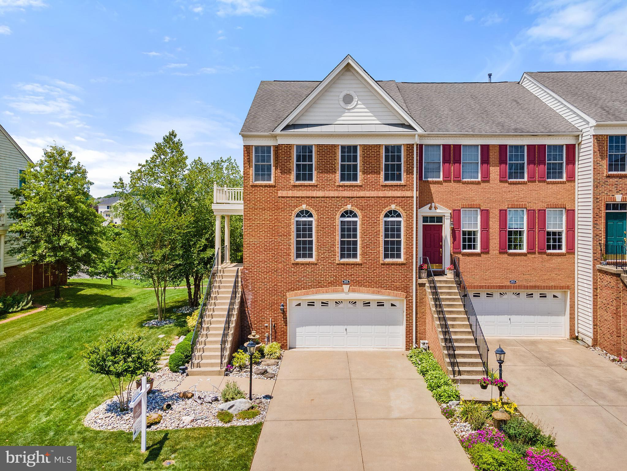 Welcome Home to 22615 Upperville Heights Sq., Ashburn VA.  This Beautiful Brick Front End Unit Townhome with a Large Stunning Backyard Patio, Mature and Manicured Landscaping with Irrigation System while Overlooking the Magnificent Body of Water that is Perfectly Situated Behind this Home for Amazing Water and Serene Views.  This Home Features 3 Levels, 3 Bedrooms, 3.5 Bathrooms, Large 2 Car Garage with Storage, and Approximately 3,147 of Finished Sq Ft Living Space.  The Main Level Includes Foyer, Living Room, Dining Room, Kitchen with Island, Family Room and Sunroom with Access to the Deck.  The Upper Level Includes the Large Owners Suite with 2 Walk-In Closets, Vaulted Ceilings, and Ensuite Bathroom with Soaking Tub with Separate Shower Along with 2 Additional Generous Sized Bedrooms with Vaulted Ceilings, Full Bathroom and Laundry.  The Lower Level Includes Second Family Room Area / Recreation Room, Full Bathroom, Work Out Area, Access to the 2 Car Garage and Walk-Out Access to the Large Stunning Paver Patio and Backyard.   This Home is Conveniently Located to Shopping, Restaurants, Movie Theatre, Library, Access to Major Roadways for an Easy Commute to Northern Virginia, Washington DC, and Maryland.  The Brand-New Silver Line Metro that will be Opening in the Near Future is within a 5-10 Minute Drive and Access to Dulles International Airport is a Short 10-15 Minute Drive Away.  Amenities within Loudoun Valley Estates Includes Swimming Pool, Clubhouse, Fitness Center, Walking Trails, Pond with Fountain Just Behind the Home, Tennis Court and Soccer/Baseball fields.