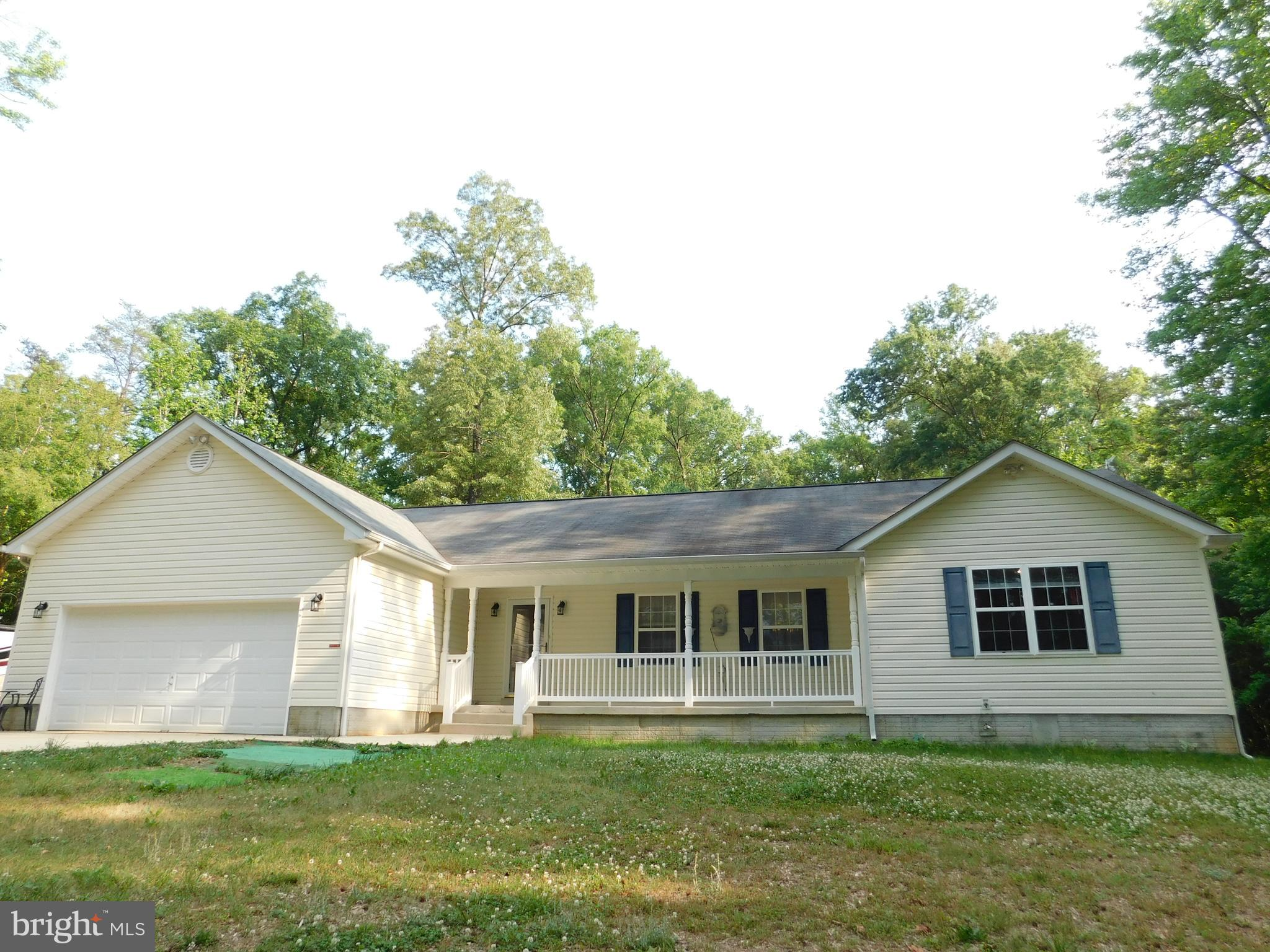 Take to the woods and celebrate nature in country comfort!  Privately sited on more than 6 acres, th
