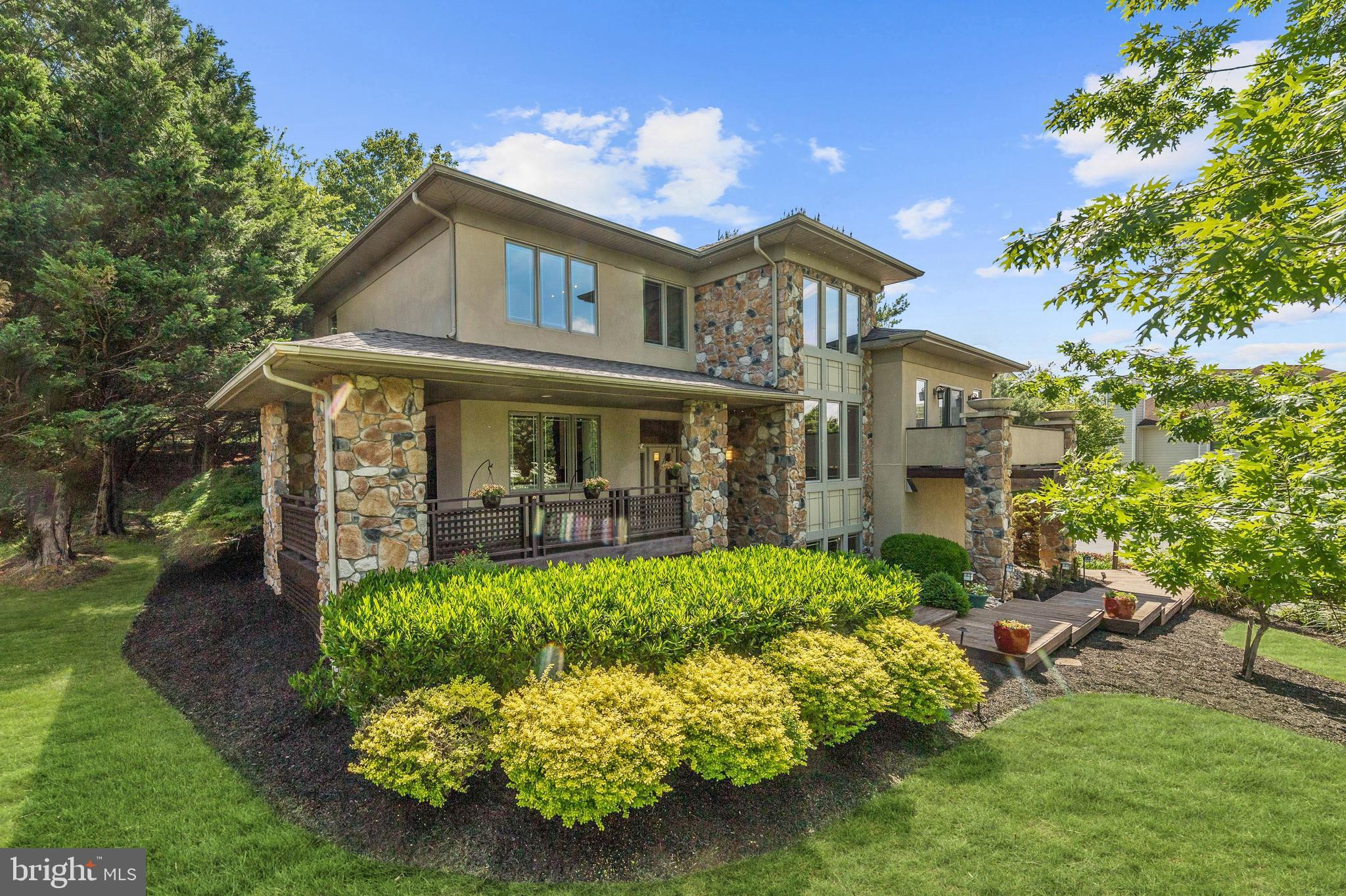 Stunning Frank Lloyd Wright-inspired custom home in the highly sought-after Woodridge at Lake Lingan