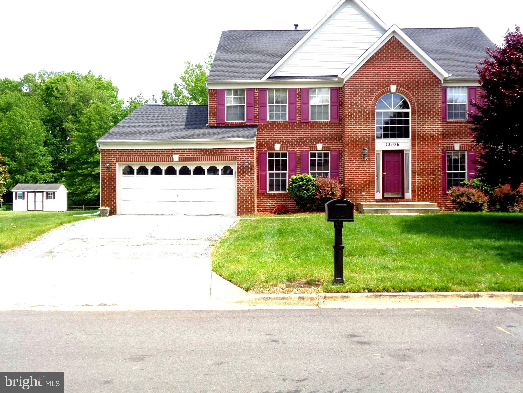 This 3006sq. ft. brick front sq ft Colonial is located on a quiet street leading to a cul-de-sac and