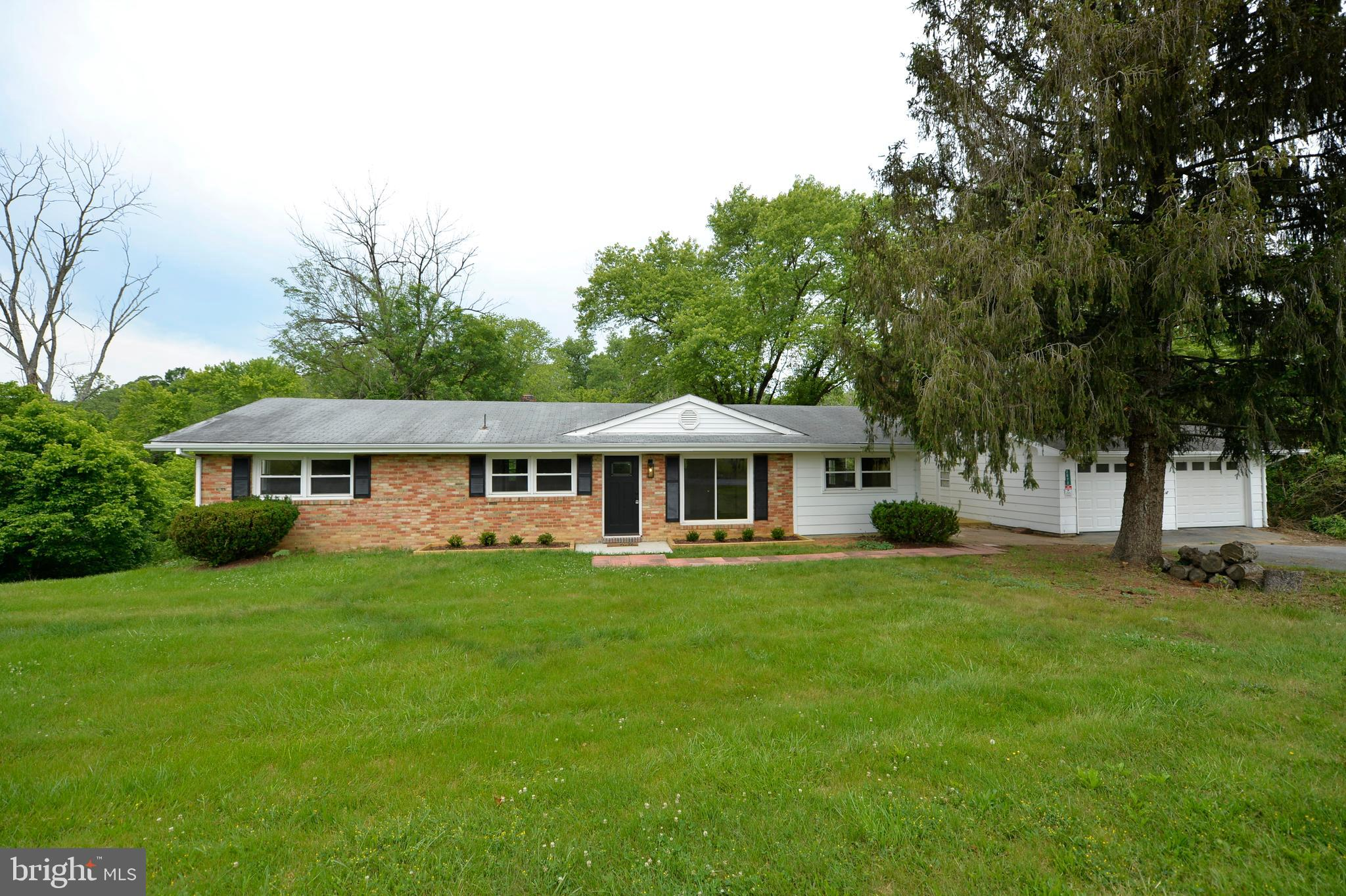 Wow! Stunning single-family home located on 2.5 acres along the serene Opequon Creek in Clarke Count