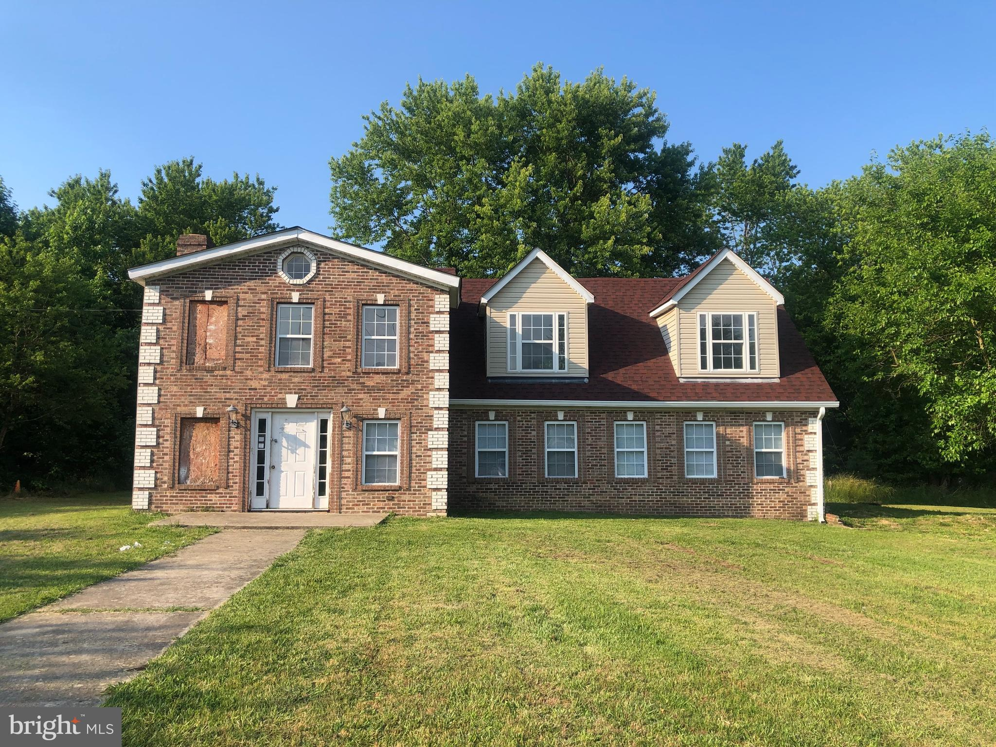Great opportunity for the savvy investor or homebuyer looking to transform this large house into a beautiful home.