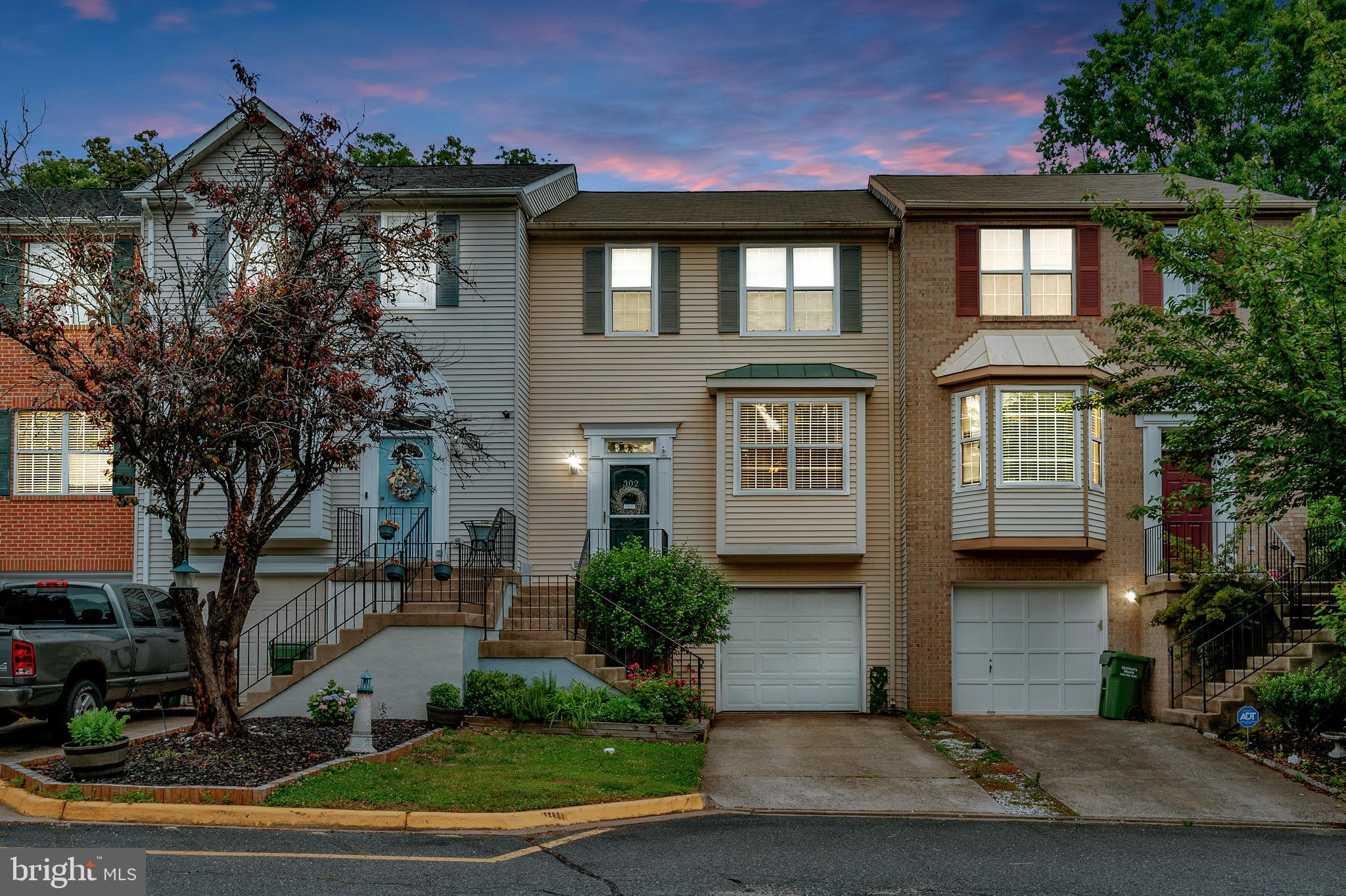 Welcome Home!   Conveniently located less than 5 miles to 95 & commuter lots.  This move in ready 3 lvl townhome w/ one car garage will impress.  Tucked back on a quiet  cul de sac, You will be warmly greeted the moment you walk in !  The bight eat in kitchen  includes a pantry w/ plenty of counter space and room for a small table.  Formal dining room and living room w/ gas fireplace.  Sliding door leads to deck overlooking private yard backing to trees.  Upper level  2 master suites. 1 w/ skylight soaking tub and sep shower  the 2nd full bath  shower/tub combo   Lower level.  is fully finished includes gas fireplace. possible 3rd bedroom  & a Half bath.  Sliding door walks out level to back yard