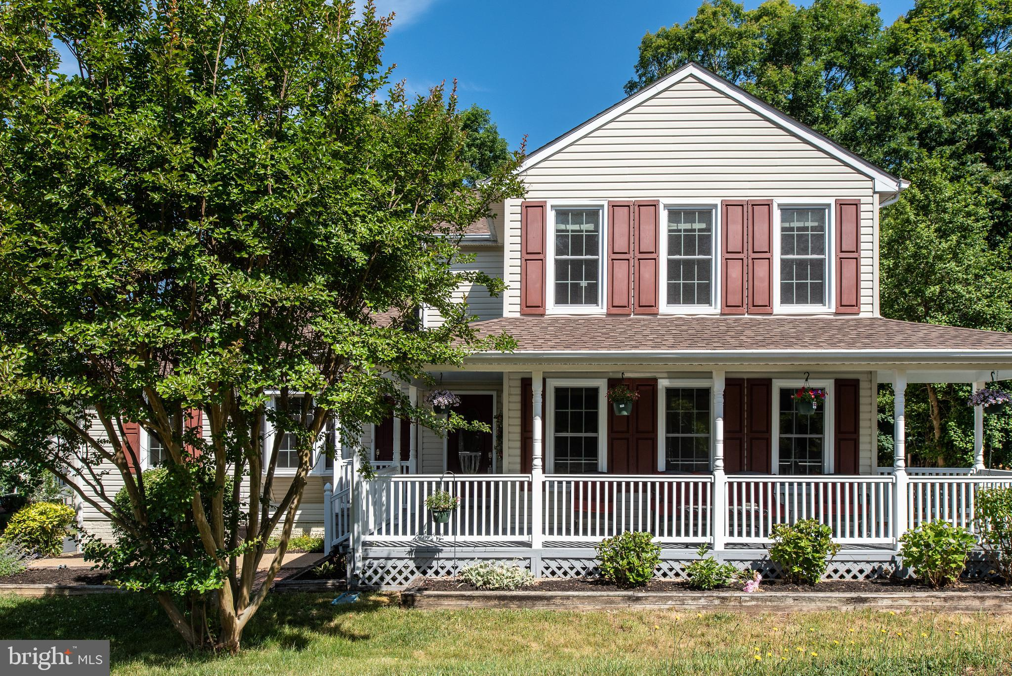 PRICE IMPROVEMENT  Looking for that much needed Space...look no more! This Spacious Colonial with a Wrap Around Porch sits on a corner lot in a sought after neighborhood. The Location is a prime spot for commuter lot, VRE, Shopping and much more. This 3 level Colonial has the perfect set up . Use the separate Au Pair/In Law Suite that has it's own entrance, 2 bedrooms , Jack & Jill Bath, Full Kitchen and Large living area. This Suite has it's very own HVAC unit that was replaced in 2020 to include a nest thermostat. A separate entry way leads you into the attached  Main home that has more than enough space and storage, you'll think you have two separate homes! All new PELLA Windows throughout wrapped in vinyl clad on the exterior. New Shutters, New Deck on the Rear to sit and enjoy the sound of nature. This part of the home has an additional 2 dual fuel HVAC units that are less than 5 years old with upper and lower thermostats. Newer water heater, Roof is only 5 yrs, Installed 5/21 Brand New Carpet in Family Room, Newer Carpet in Upper level, Newer Appliances . Maint. Free PVC trim wrapped around garage, My Q garage hub. Home has just been power washed, landscaped & mulched.  Lower level has it's very own workshop, a possible 6th bedroom, storage room and wait until you pull your vehicle into this oversized 2 car garage! This home has it all, you won't be lacking for anything and it certainly won't disappoint!