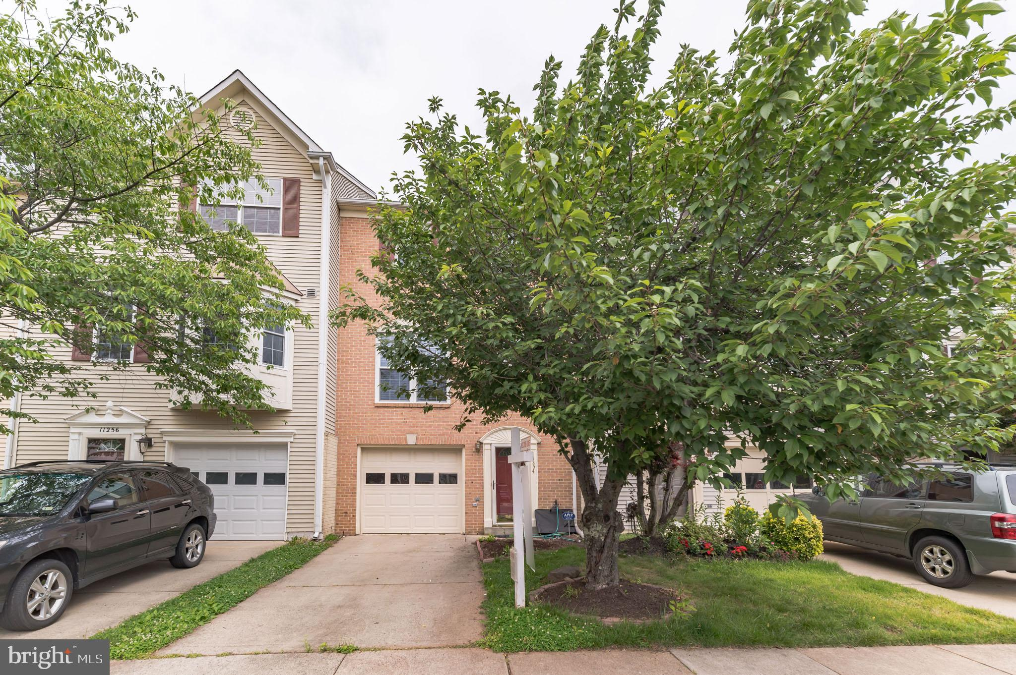 Well maintained  brick front Townhouse with one car garage, Driveway,  one Assigned Parking Space an