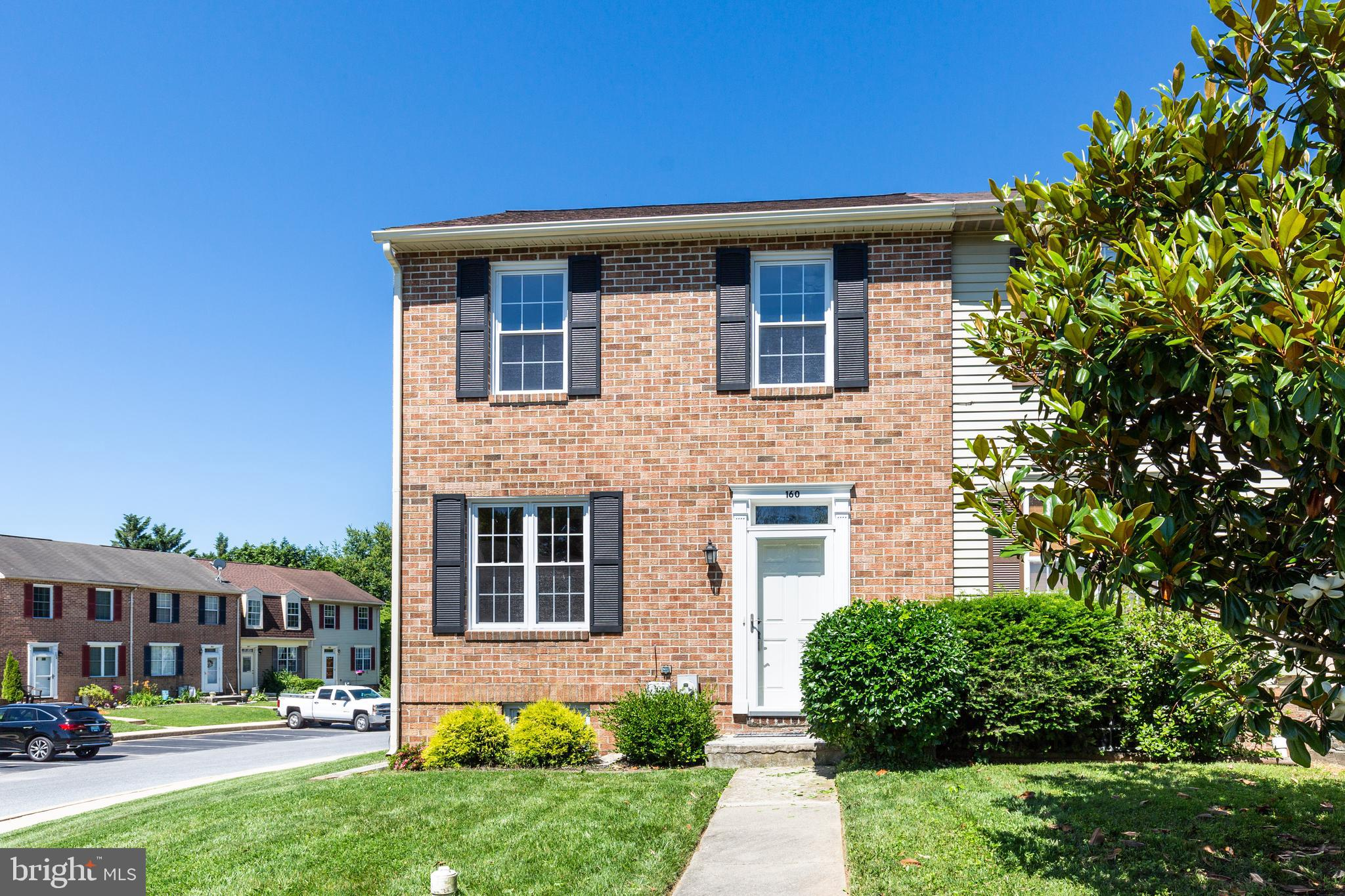 End unit brick front TH in Carroll Meadows!  Gleaming hardwood floors till greet you as you walk ins