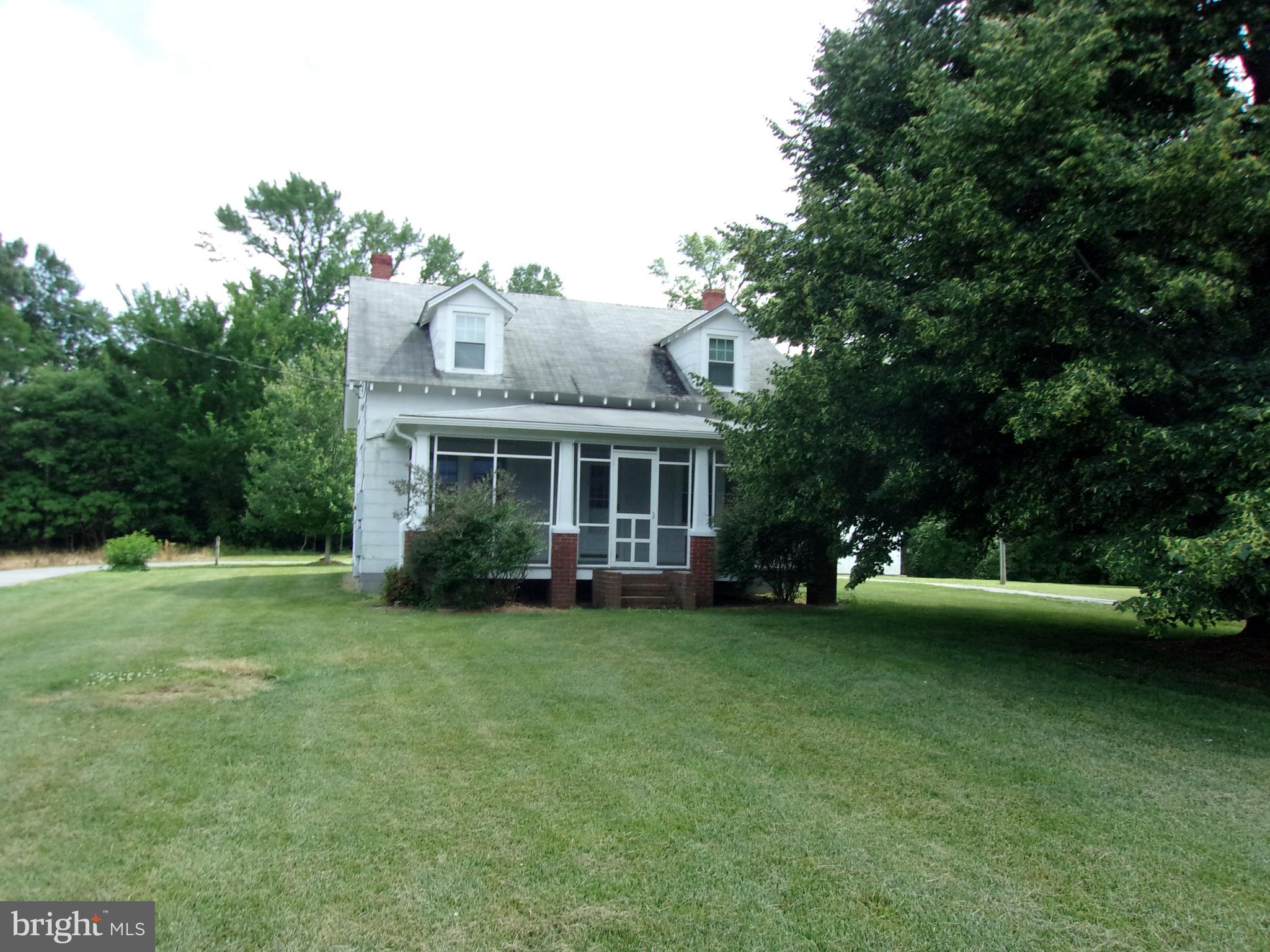 Very nicely maintained home on 4 acres.   Features include hardwood floors, enclosed sun porch, screened front porch, and sizable living room and separate dining room.   There is an unfinished basement and 3 outbuildings for additional storage space.  The home was rewired in 2005, a new furnace added in 2005, new roof on garage in 2013,  and new garage door with remote in 2018. An outstanding opportunity to live near Nomini Creek at an affordable price.