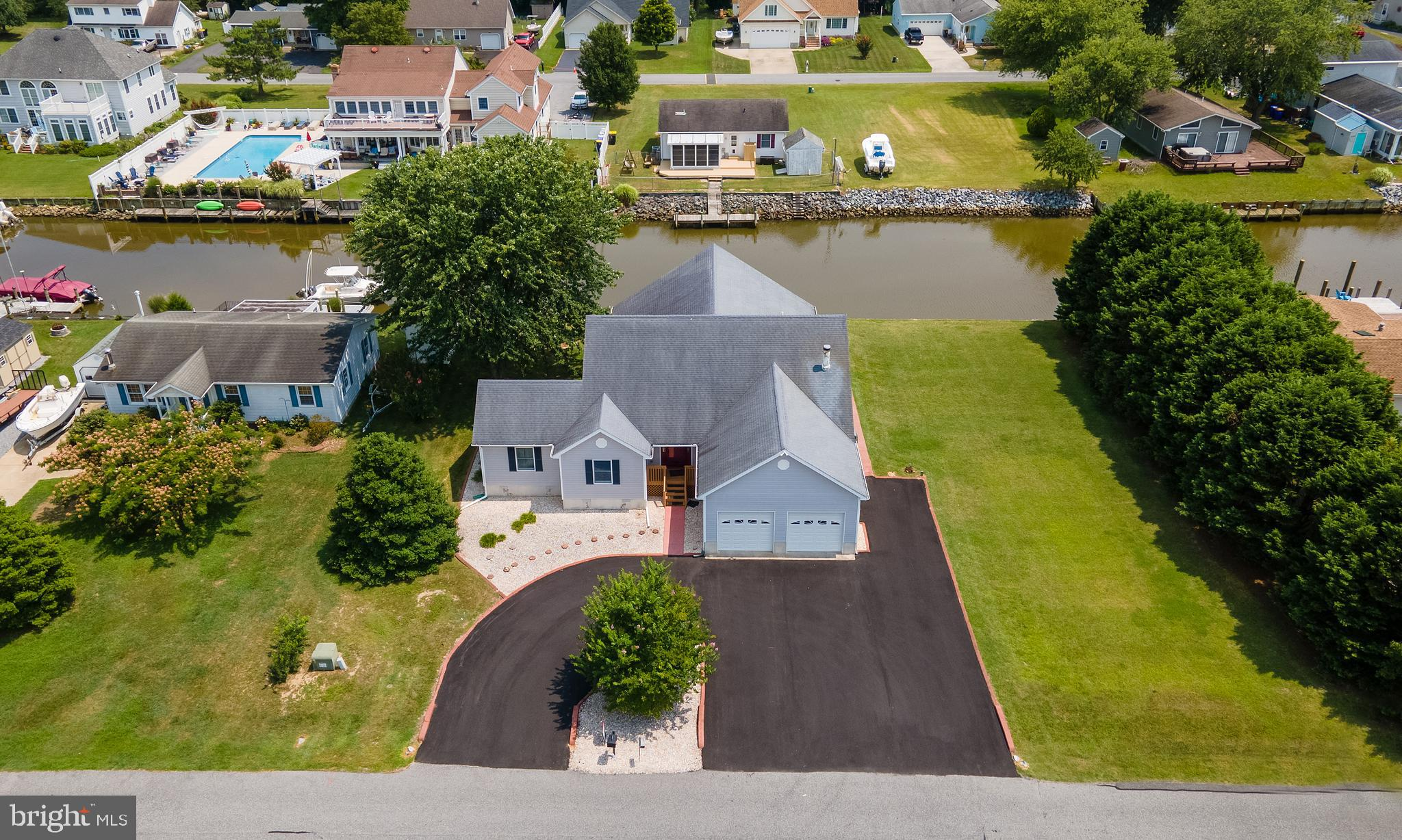 This waterfront home sits on a double lot in Bayview Estates. The unfinished 2nd story can add anoth
