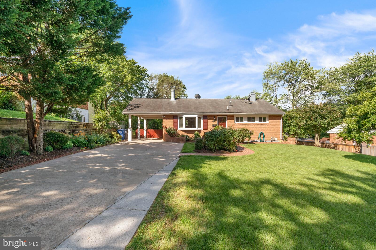 Handsome all-brick 2 level rambler sited on a gorgeous 10,200 sq.ft manicured lot**Enjoy over 1,800