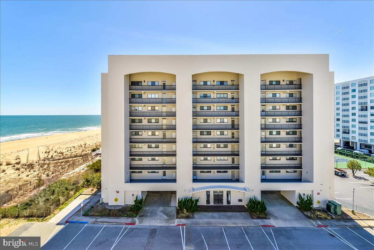 Wow! Seldom available property in Camelot B. This beautiful spacious 2BR/2BA condo is just one back from direct ocean front, and being sold by the original owner. Enjoy both captivating ocean views from the large balcony that also overlooks the  beautiful property grounds. Unit offers oversized utility room with full size washer/dryer, kitchen updated SS fridge and dishwasher.  Newly replaced slider and HVAC in 2021. Community amenities include an olympic size pool, tennis courts, plenty of parking with off street parking. Never in a rental program, and condo is in excellent condition. Enjoy the far less dense beaches of North Ocean City close to many popular restaurants, shopping, amusements, Fenwick Island DE and Northside Park is within walking distance.