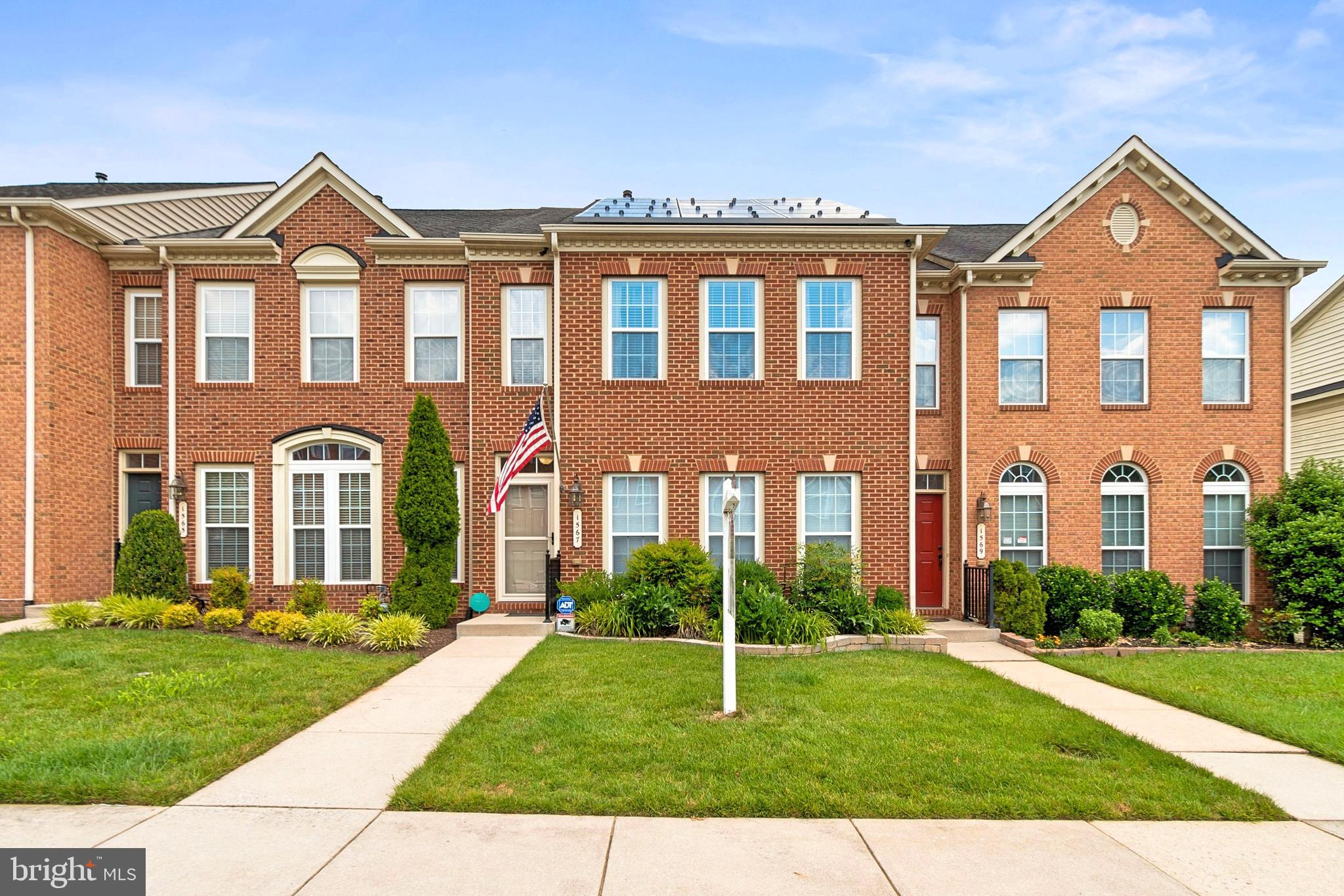 Gorgeous, Spacious Townhome in the sought-after community of Villages of Dorchester. Constructed in late 2007 by NVHomes, Astor Level Entry with 8-foot extension. Upon entering your home through the new Larson front storm door (2020), you are greeted by the elegant Living Room/Dining Room combination with regal columns, large windows, and crown molding. Bask in the dazzling Bruce Cherry hardwood floors adorning your open-concept main level. Envision yourself creating memories, sharing conversations, and discovering new recipes in your gourmet Kitchen, which features granite countertops and modern stainless-steel appliances. Appliances include; Whirlpool gas cooktop, Kenmore built-in microwave with grill feature (2009), GE dual wall ovens with convection (2017), Whirlpool refrigerator (2017), and KitchenAid dishwasher (2018). Ample storage is provided by the custom built pantry made by California Closets. On warm evenings or crisp fall days, relax on your low maintenance composite rear deck with vinyl railing system as you bask in the beauty of the woods bordering your home. Atop the home, escape to your oasis of luxury in your Primary Bedroom. Read a book or listen to your favorite podcast in your seating area overlooking the woods. Enjoy ample storage space in the massive walk-in closet. The luxurious ensuite features granite double sinks, soaking tub, and a stall shower.   Travel to the lower level, complete with Recreation Room, Home Office, Full Bath, and walk out access to the rear patio. The lower level offers the wonderful chance to customize the area to suit your needs. Significant technology and mechanical upgrades have been made; New Carrier HVAC (2017), Tankless water heater with recirculation (2020),  CAT6 network wiring, 4K surveillance system with NVR,  HDMI jacks above the fireplace,  To view the full list of features and upgrades, please see the attached documents. Book your appointment today!