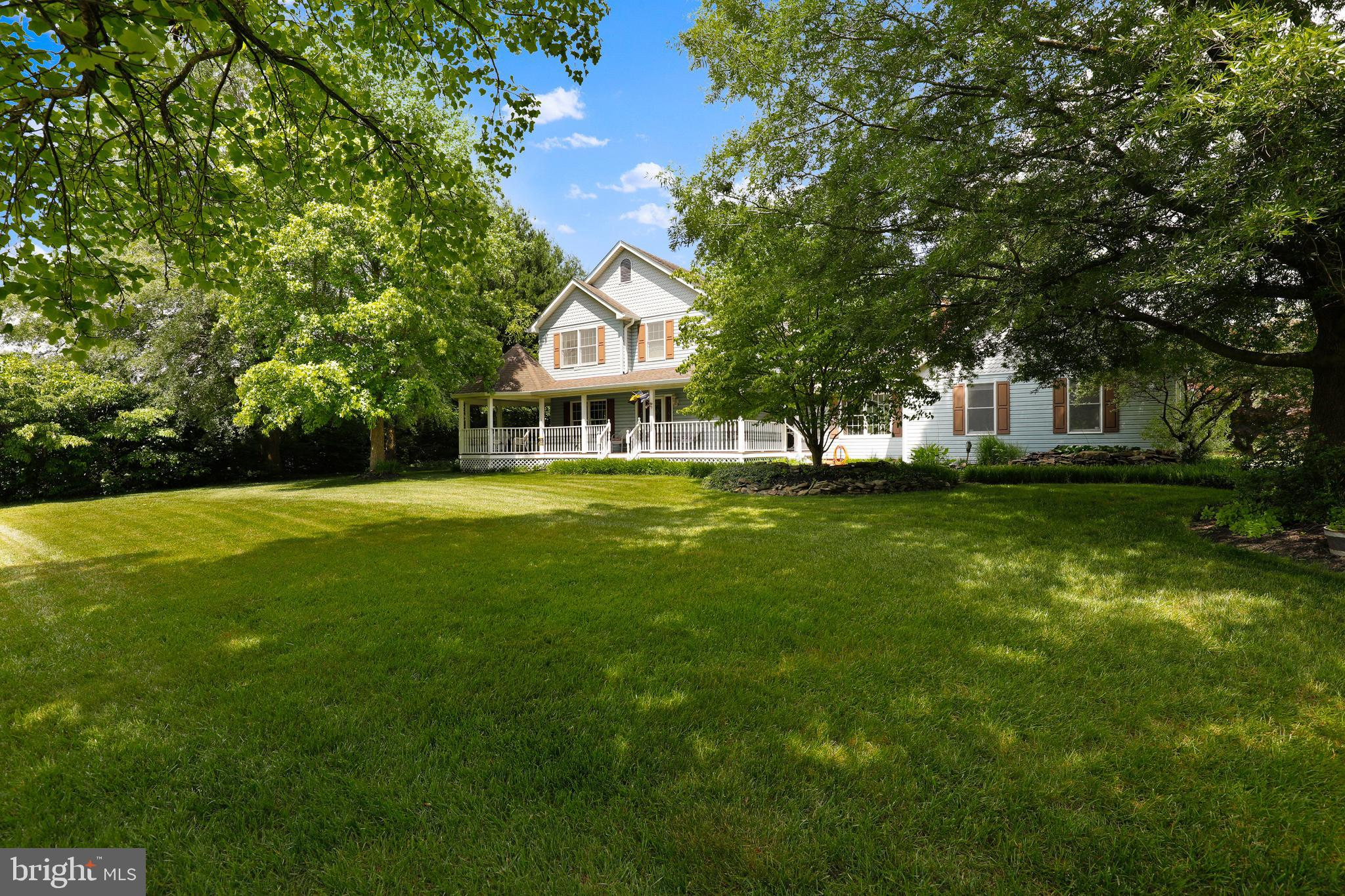 Sited on a flat landscaped .99 acre lot is this traditional 5 Bedroom, 3/1 Bath home.  Welcoming wra