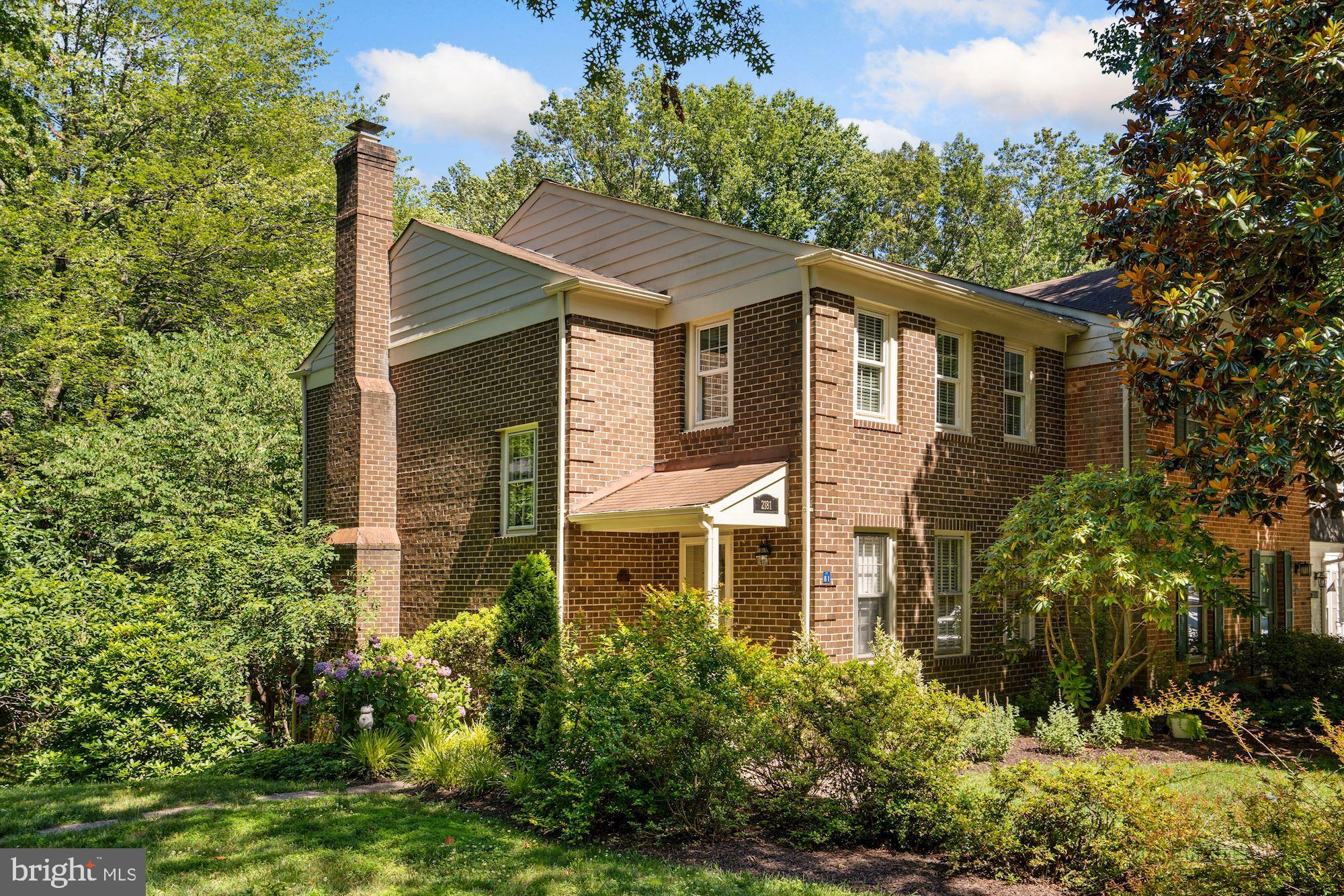 All brick end-unit townhouse backing to trees and overlooking common grounds . Updated kitchen.  All