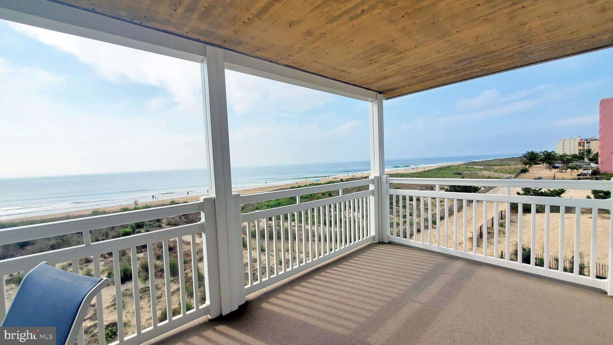 Direct oceanfront penthouse south corner condominium with 3 bedrooms 2 bathrooms.   Enjoy ocean breezes and sounds of the ocean all year long on the oversized deep deck.    Upon entrance of the property, you will notice that it has been well cared for with updated kitchen, laminate flooring, tile, updated bathrooms, new baseboard heat, new built-in microwave, newer window units (5 Years), ceiling fans and more.   The complex has been well maintained with a new roof 12 years ago, new railings and currently having all new vinyl siding installed.  If you are looking for a 3-bedroom oceanfront in a small building under 600 with easy access to the beach this one is for you.