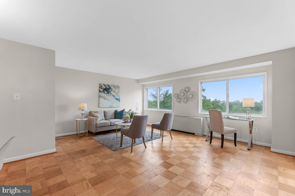 Sun-filled 1 bedroom PLUS den unit at University Towers in Silver Spring!  Monthly condo dues includ