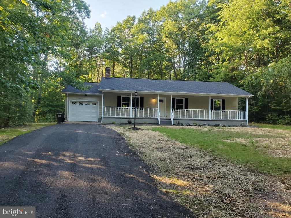 One level living at its best!Over an acre of land surrounded by mature trees and a beautifully remod