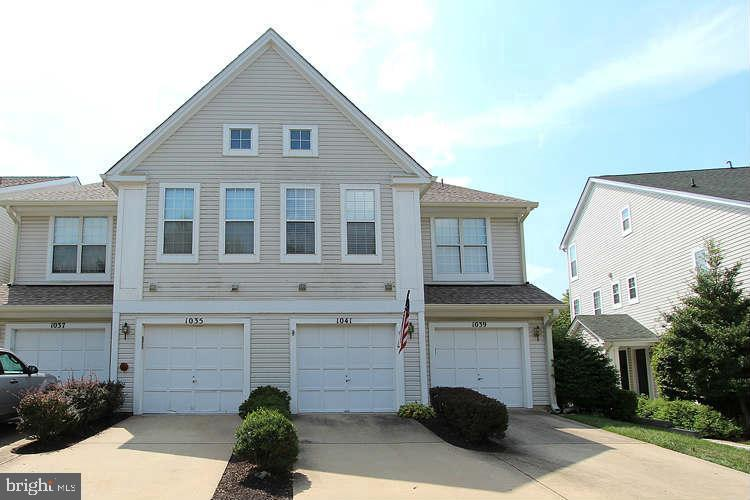 Don't miss out! End unit and backed to the woods: Welcome home to this beautiful two level two bedro