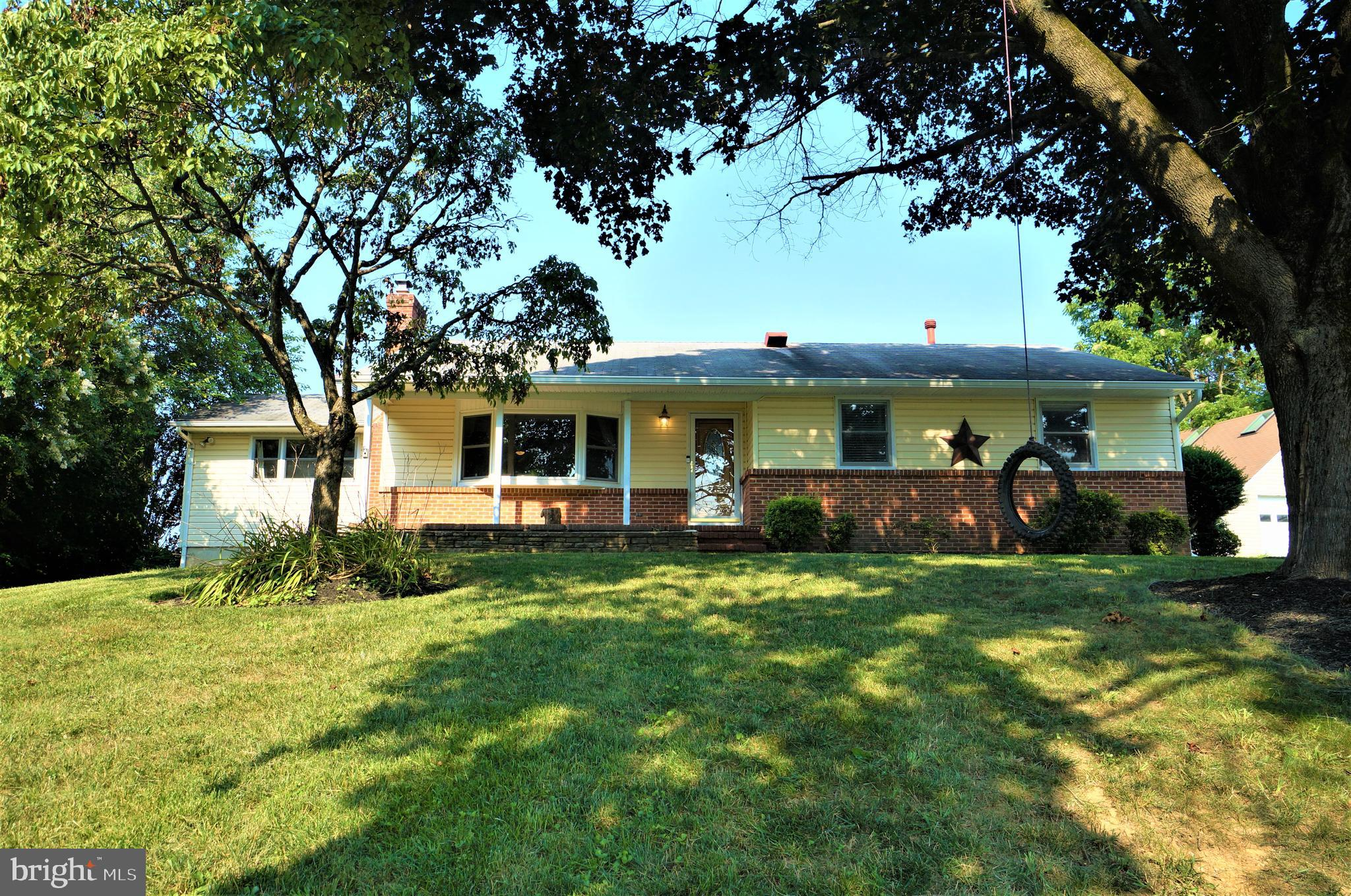 Wonderful Updated & Expanded Rancher sited on a ½ Acre Lot! Family and Breakfast/Sunroom Additions *