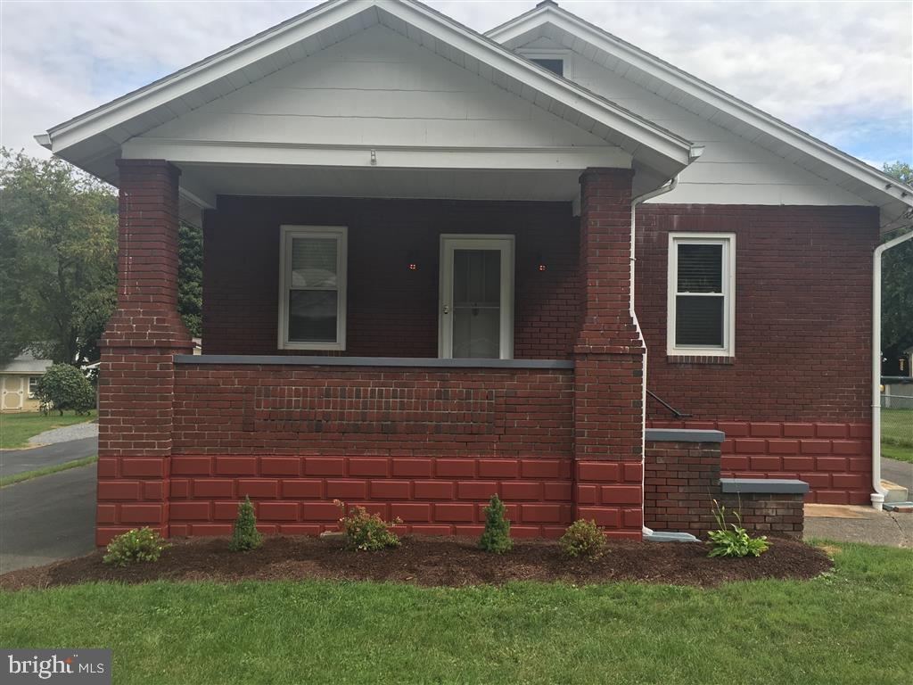 All-brick quaint cottage bungalow located in the heart of LaVale.  Maintenance free exterior, vinyl